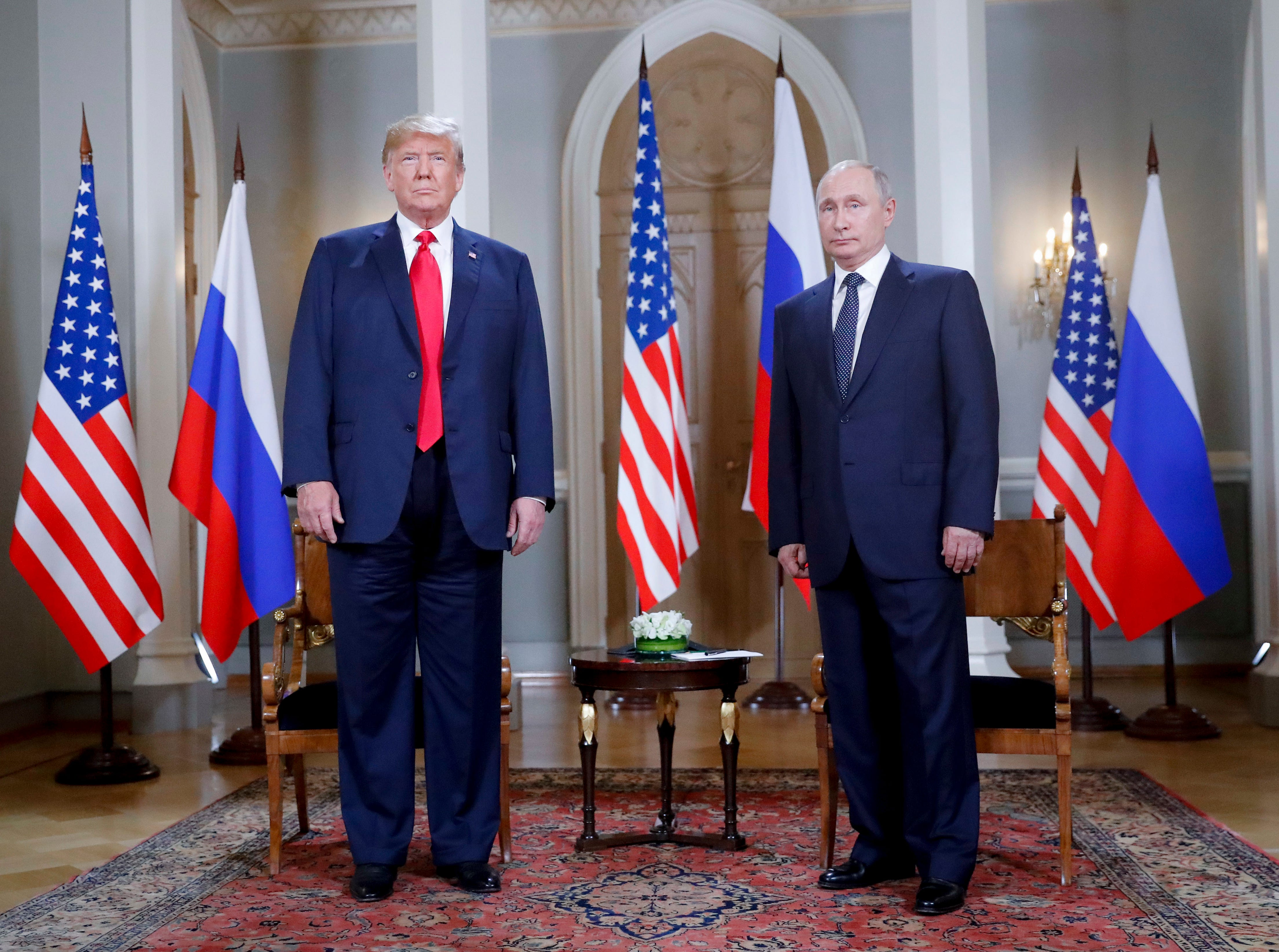 US President Donald Trump and Russian President Vladimir Putin, right, pose for a photograph at the beginning of a one-on-one meeting at the Presidential Palace in Helsinki, Finland, Monday, July 16, 2018.