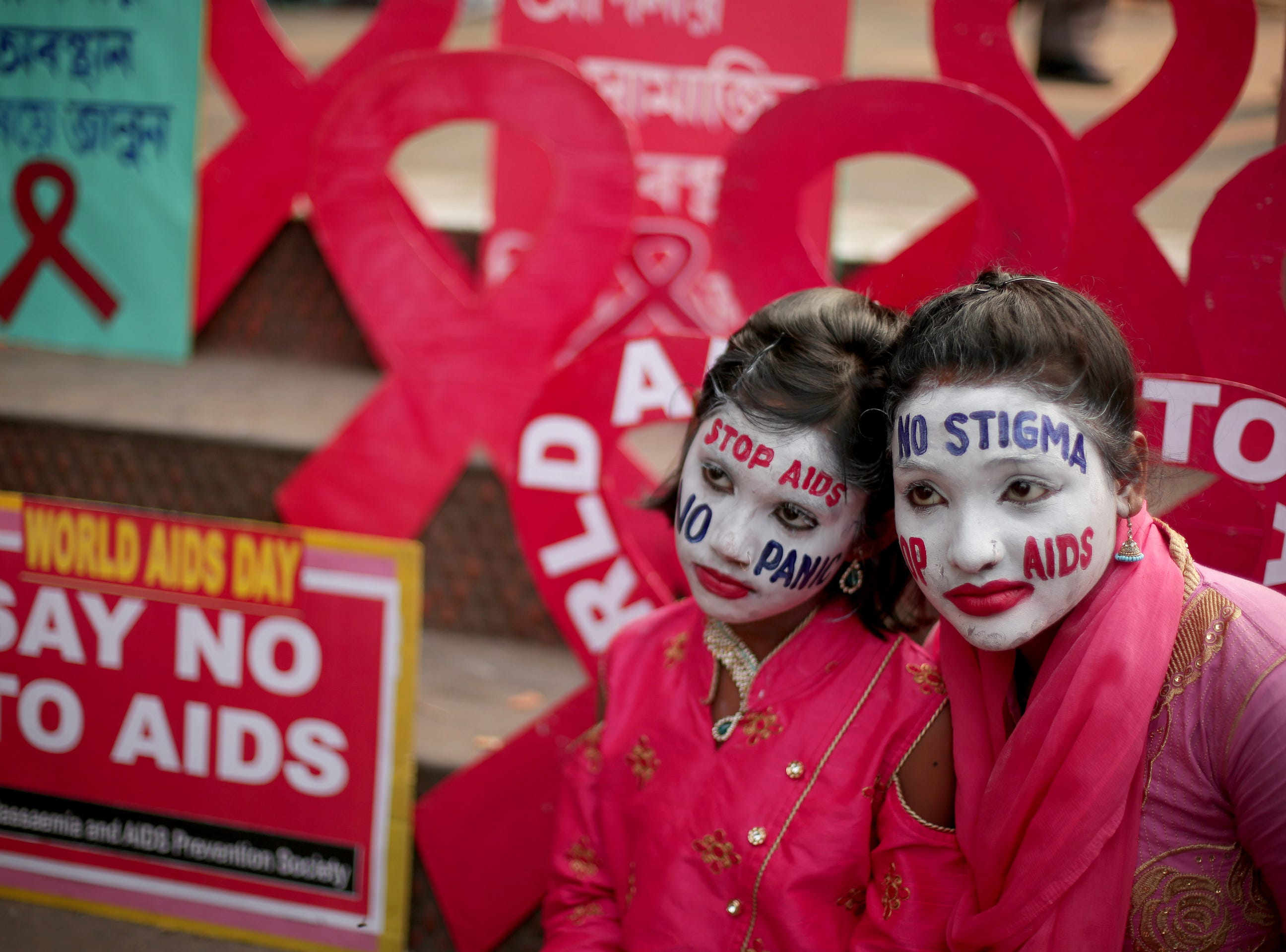 Activists attend an AIDS awareness campaign on the eve of World AIDS Day in Kolkata, Eastern India on Friday.  World AIDS Day is observed with calls from international health and advocacy organizations for the public to get involved in programs for awareness, prevention and treatment of HIV/AIDS.