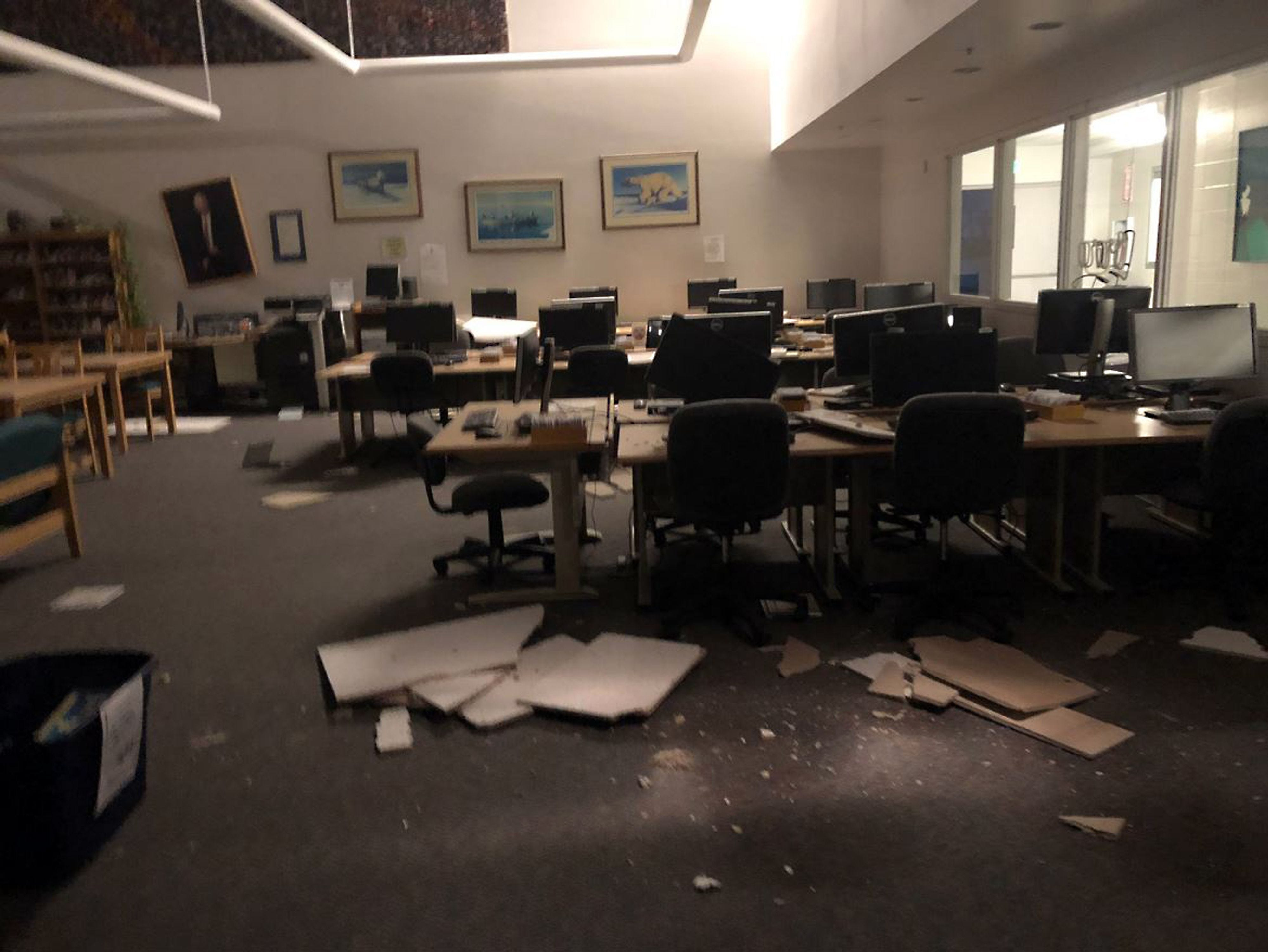 Books and ceiling tiles litter the floor at the The Mat-Su College library in Anchorage, Alaska, on Nov. 30, 2018, after a 7.0 magnitude earthquake.