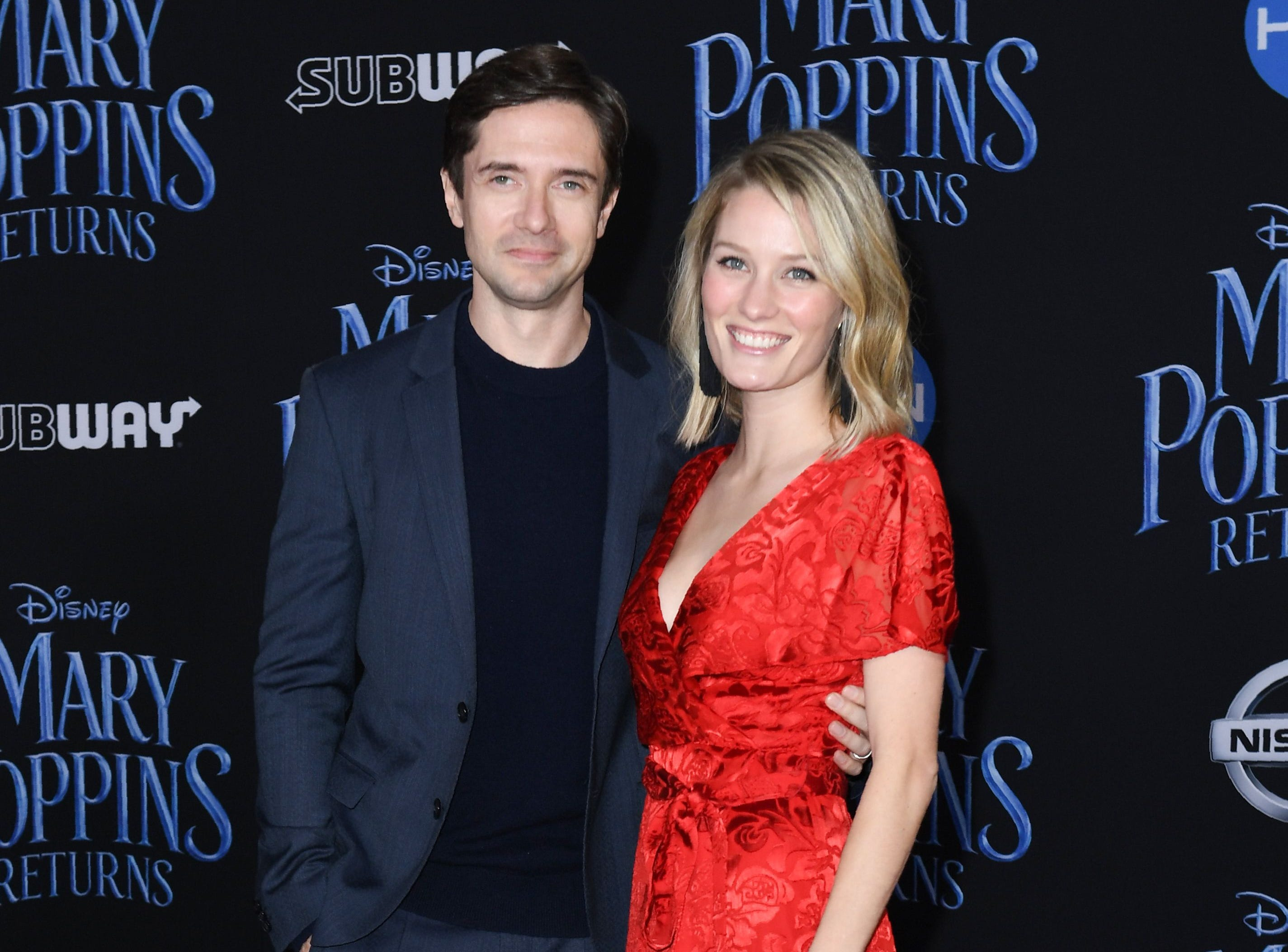 """US actor Topher Grace and his wife US actress Ashley Hinshaw arrive for the world premiere of Disney's """"Mary Poppins Returns"""" at the Dolby theatre in Hollywood on November 29, 2018. (Photo by VALERIE MACON / AFP)VALERIE MACON/AFP/Getty Images ORG XMIT: 'Mary Pop ORIG FILE ID: AFP_1B81H0"""