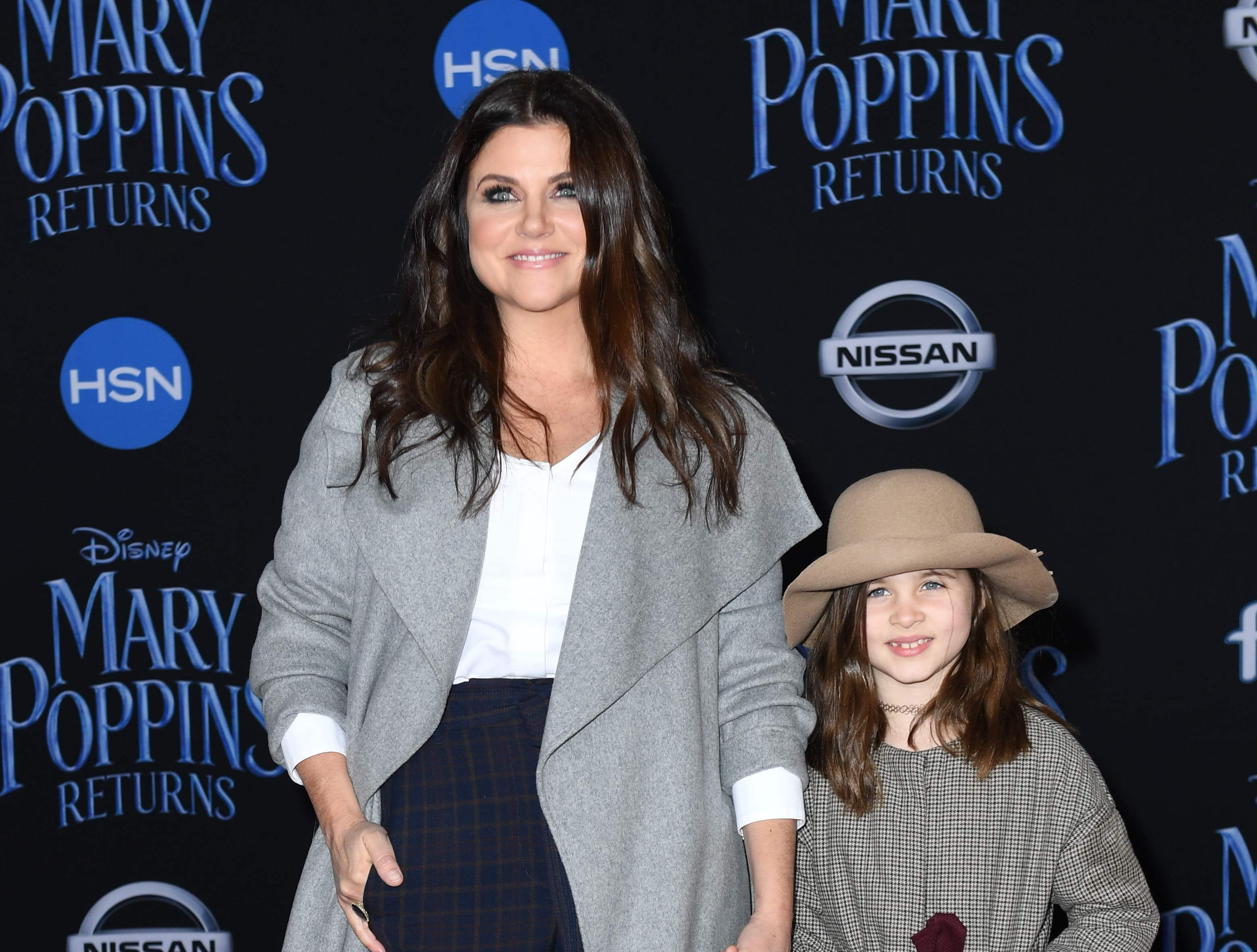 """US actress Tiffani Thiessen and her daughter Harper Renn Smith arrive for the world premiere of Disney's """"Mary Poppins Returns"""" at the Dolby theatre in Hollywood on November 29, 2018. (Photo by VALERIE MACON / AFP)VALERIE MACON/AFP/Getty Images ORG XMIT: 'Mary Pop ORIG FILE ID: AFP_1B816E"""