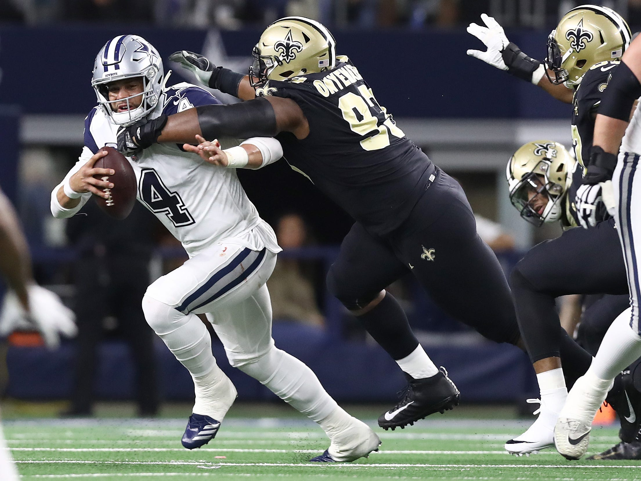 Dallas Cowboys quarterback Dak Prescott is sacked in the first quarter by New Orleans Saints defensive tackle David Onyemata at AT&T Stadium.