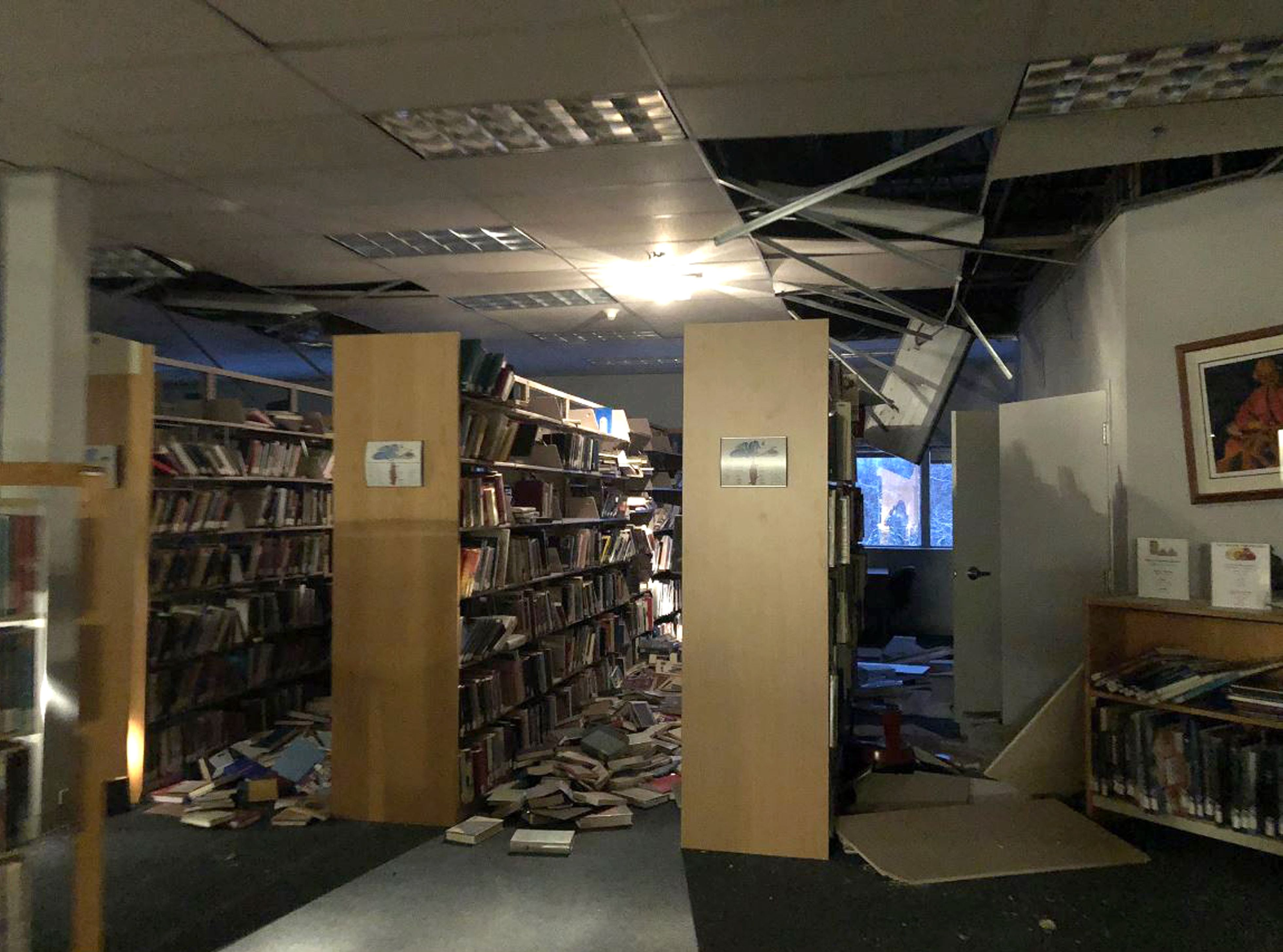 In this image courtesy of Dr. Holly A. Bell, books and ceiling tiles litter the floor at the The Mat-Su College library in Anchorage, Alaska, on Nov. 30, 2018, after a 7.0 magnitude earthquake.