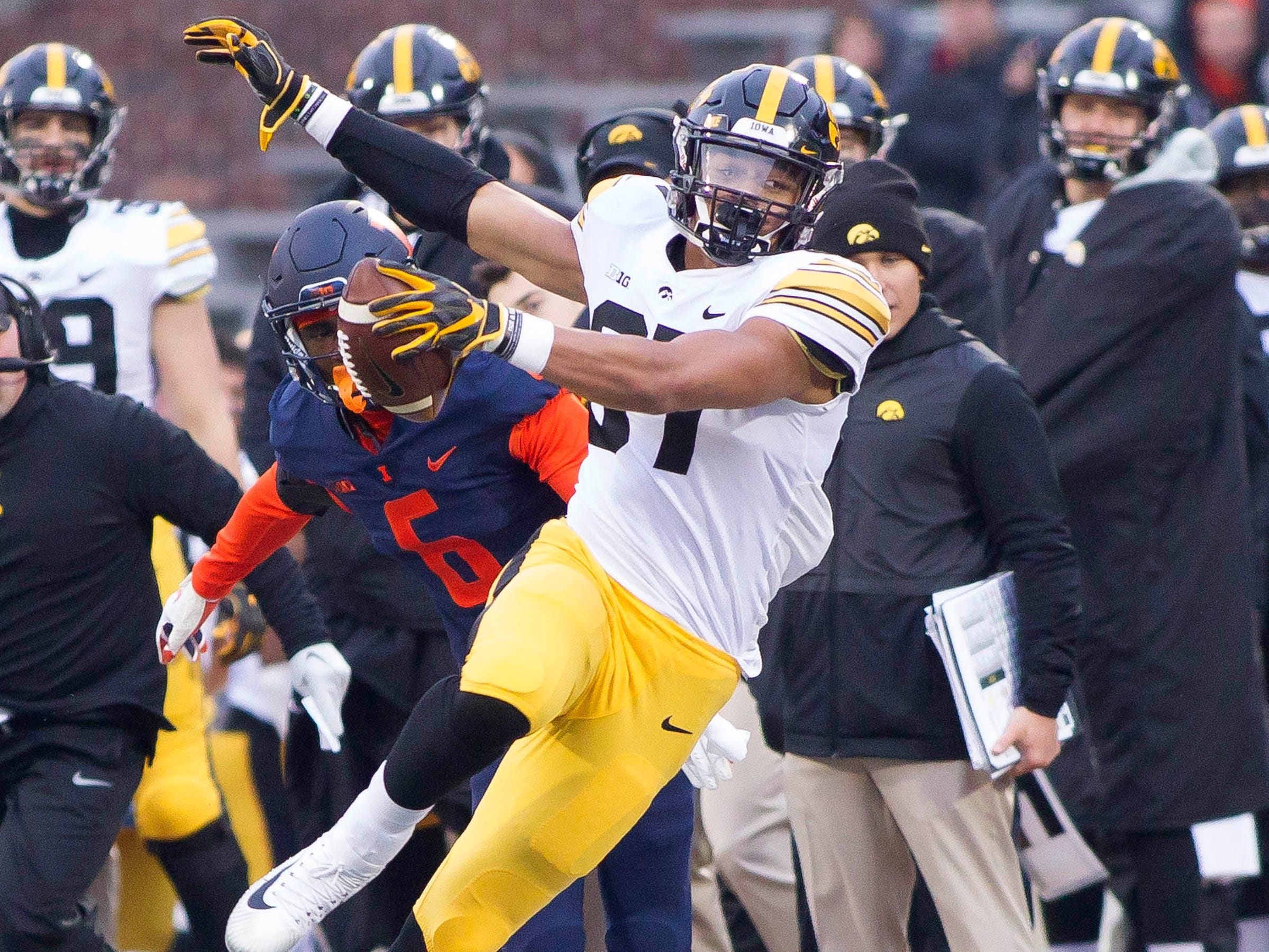 Iowa tight end Noah Fant is pushed out of bounds by Illinois defensive back Tony Adams during their game this season.