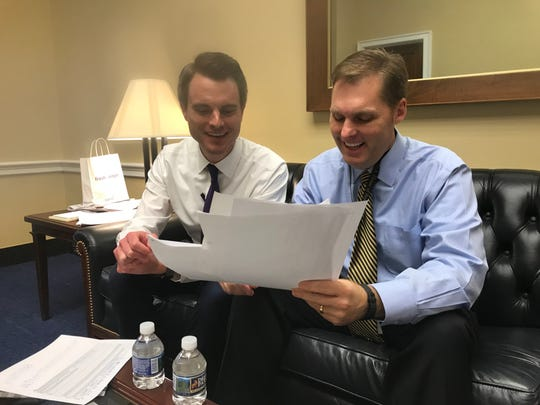 Jordan Downs, left, helped his boss Congressman-elect Michael Guest, R-Miss., look over floor plans for offices they hoped to nab in the House lottery, Nov. 30, 2018.