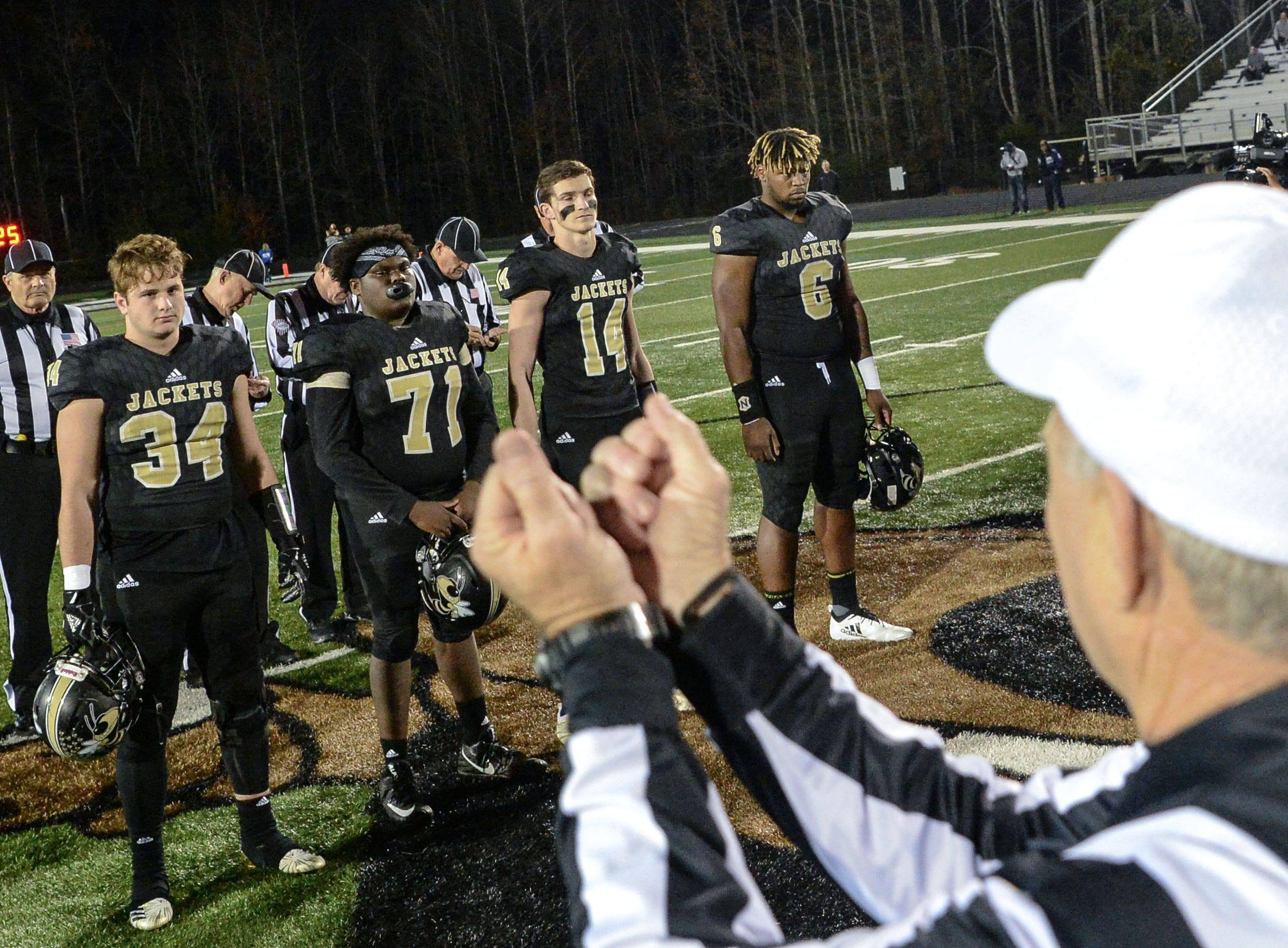 A referee signals Byrnes High School will take the opening kickoff, before the kickoff of the Class AAAAA state playoffs at TL Hanna High School in Anderson on Friday, November 30, 2018. Byrnes High School ran back the opening kickoff for a touchdown, but the Yellow Jackets came back and won 57-28.