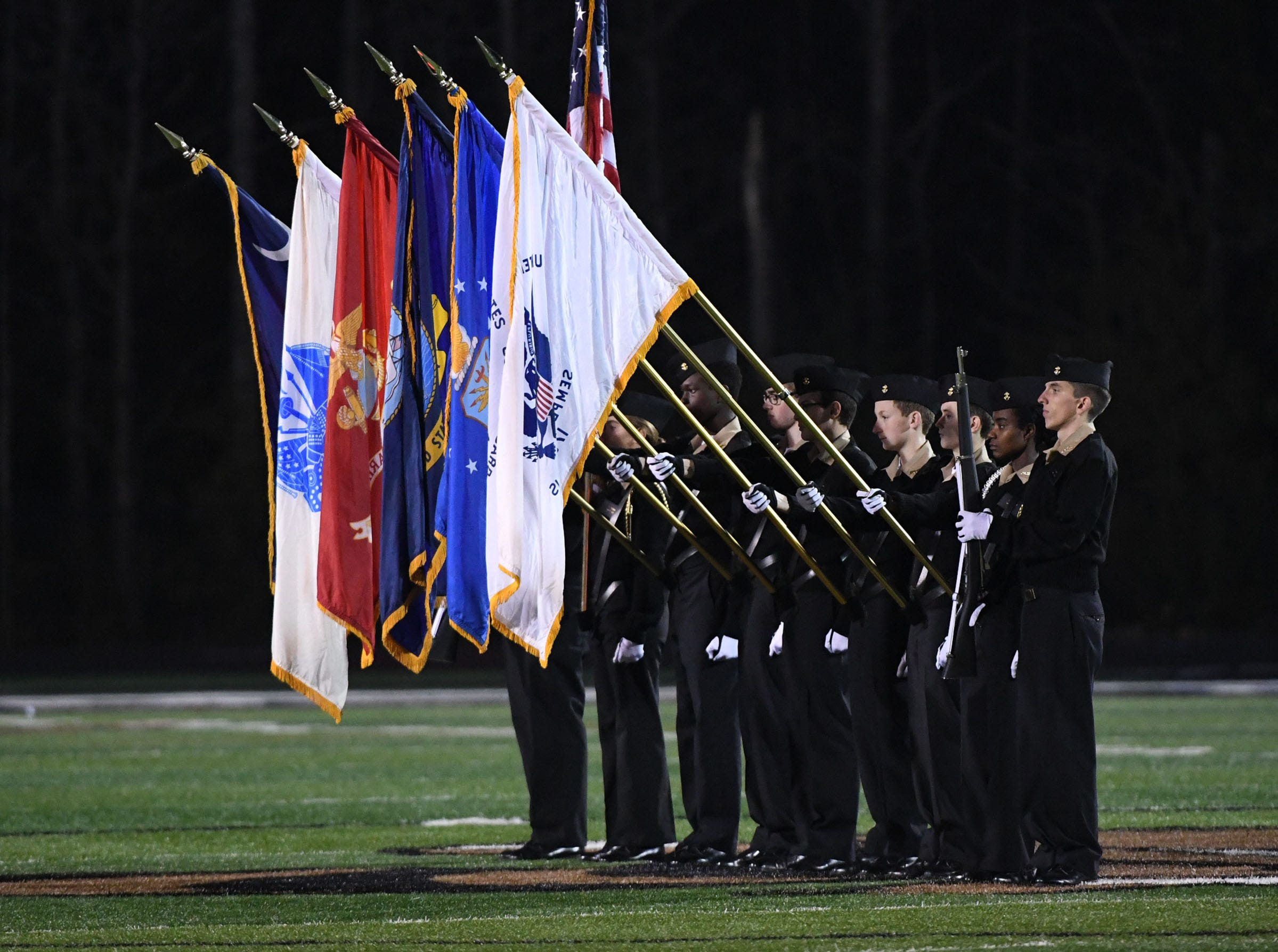 The TL Hanna High School Navy JROTC color guard present color before the kickoff of the Class AAAAA state playoffs at TL Hanna High School in Anderson on Friday, November 30, 2018.
