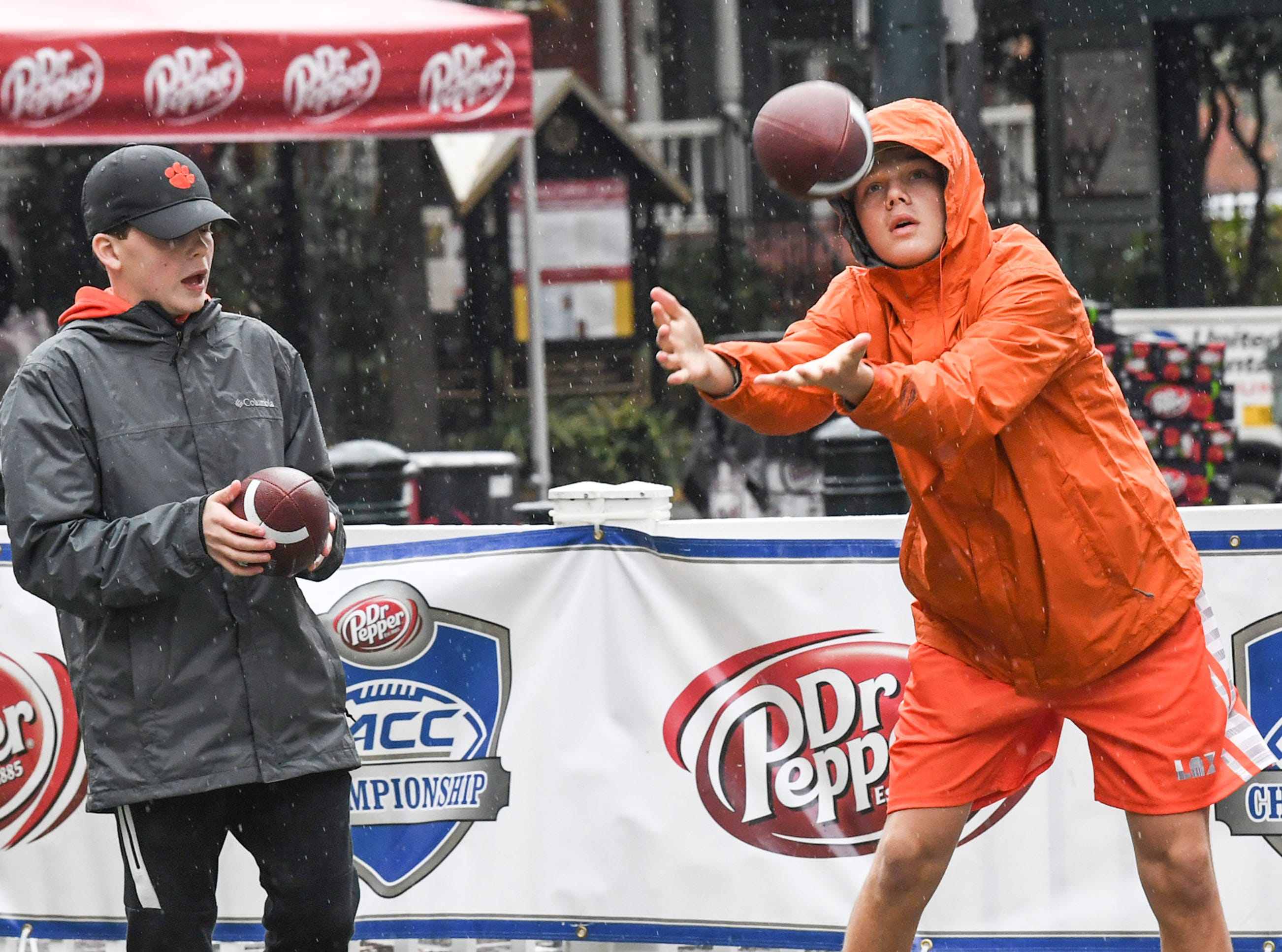 Clemson fans Michael Norris, left, and Morgan Norris, right, of Anderson, at the ACC Fan Fest in downtown Charlotte on Saturday, December 1, 2018.