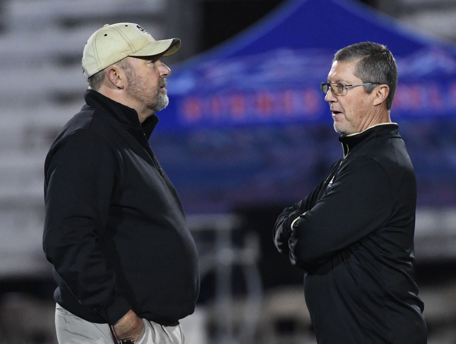 TL Hanna High School Athletic Director John Cann, left, with TL Hanna head coach Jeff Herron before the kickoff of the Class AAAAA state playoffs at TL Hanna High School in Anderson on Friday, November 30, 2018.