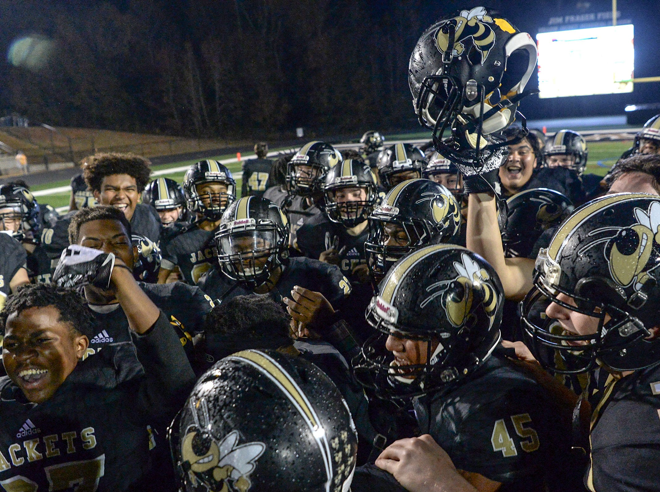 TL Hanna High School players celebrate their win over Byrnes High School after the game of the Class AAAAA state playoffs at TL Hanna High School in Anderson on Friday, November 30, 2018.