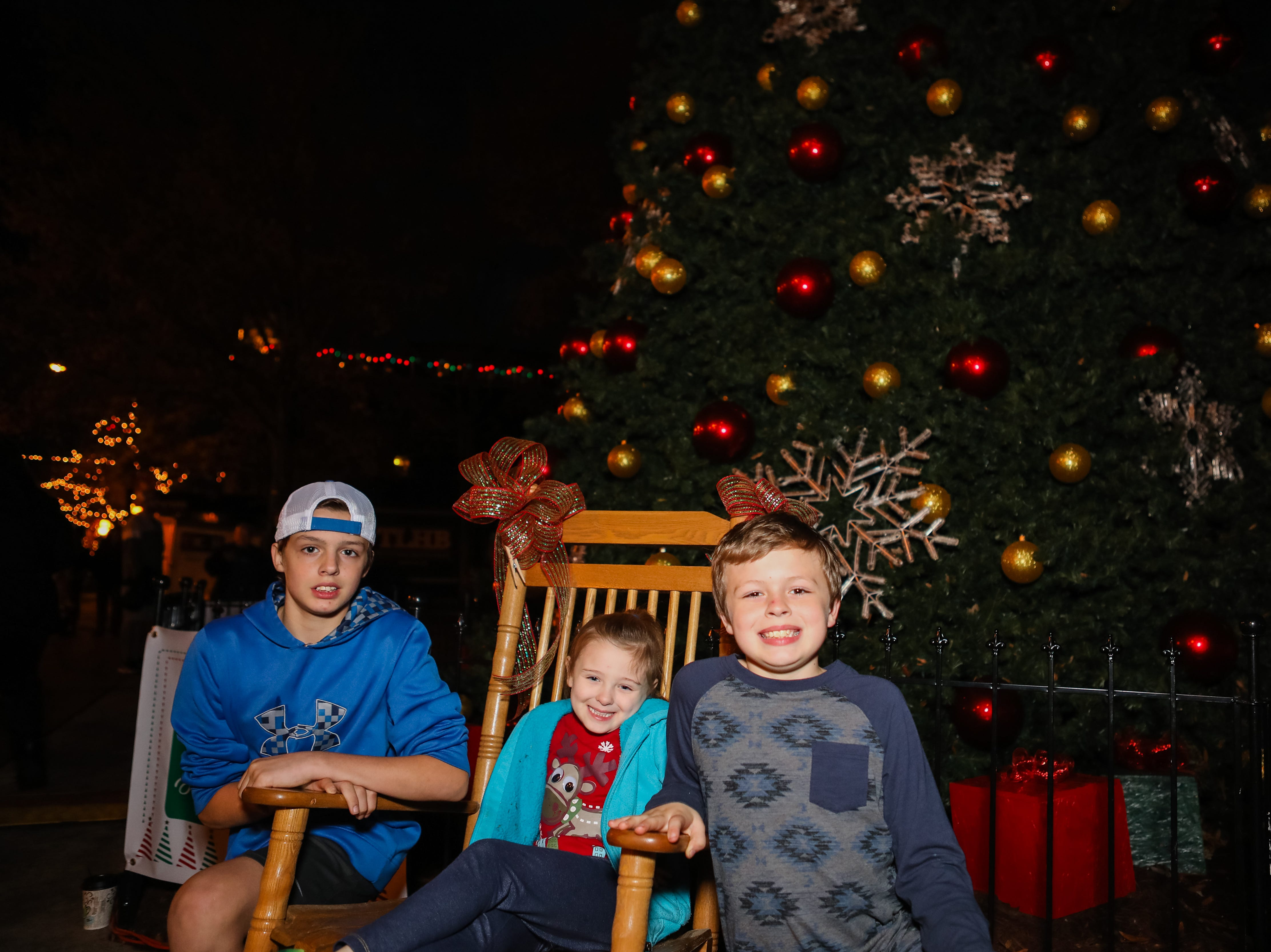 """Ayden Williams, Reagan Cantrell, and Ethan Splawn """"rock"""" in front of the Christmas Tree at the Piedmont Natural Gas Holiday Walk and Christmas Tree Lighting in downtown Anderson"""