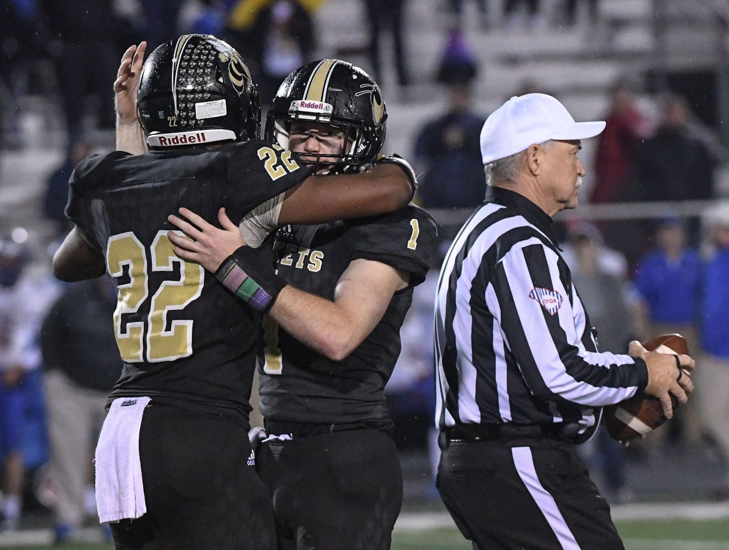 TL Hanna senior running back Jaydon McKinney (22), left, hugs senior quarterback Alex Meredith (1) raises the ball after the last play of the fourth quarter of the Class AAAAA state playoffs at TL Hanna High School in Anderson on Friday, November 30, 2018. Hanna beat Byrnes 57-28 and advances to play Dutch Fork next Saturday.