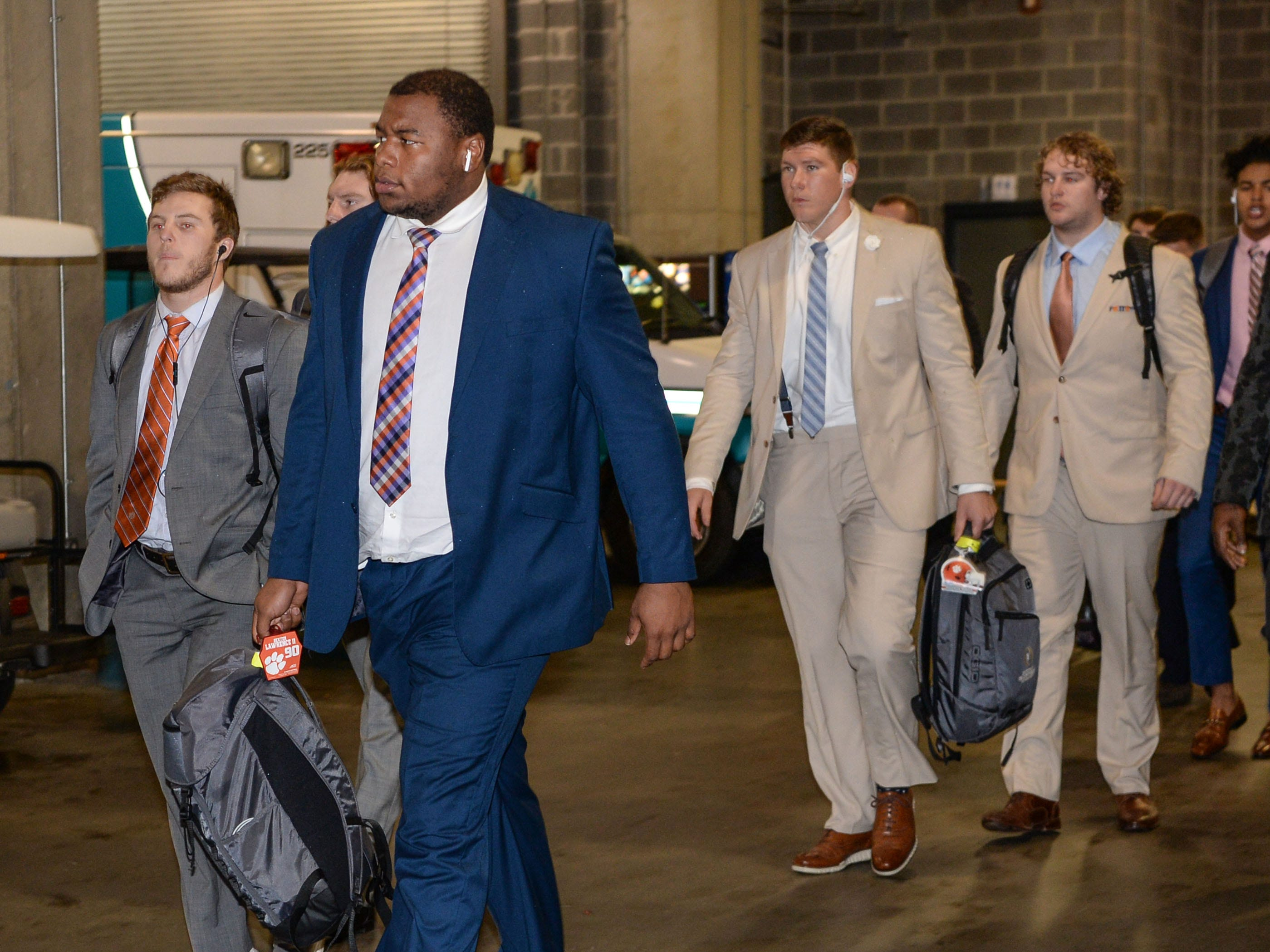 Clemson defensive lineman Dexter Lawrence (90) arrives before the game with Pittsburgh at the Dr. Pepper ACC football championship at Bank of America Stadium in Charlotte, N.C. on Saturday, December 1, 2018.