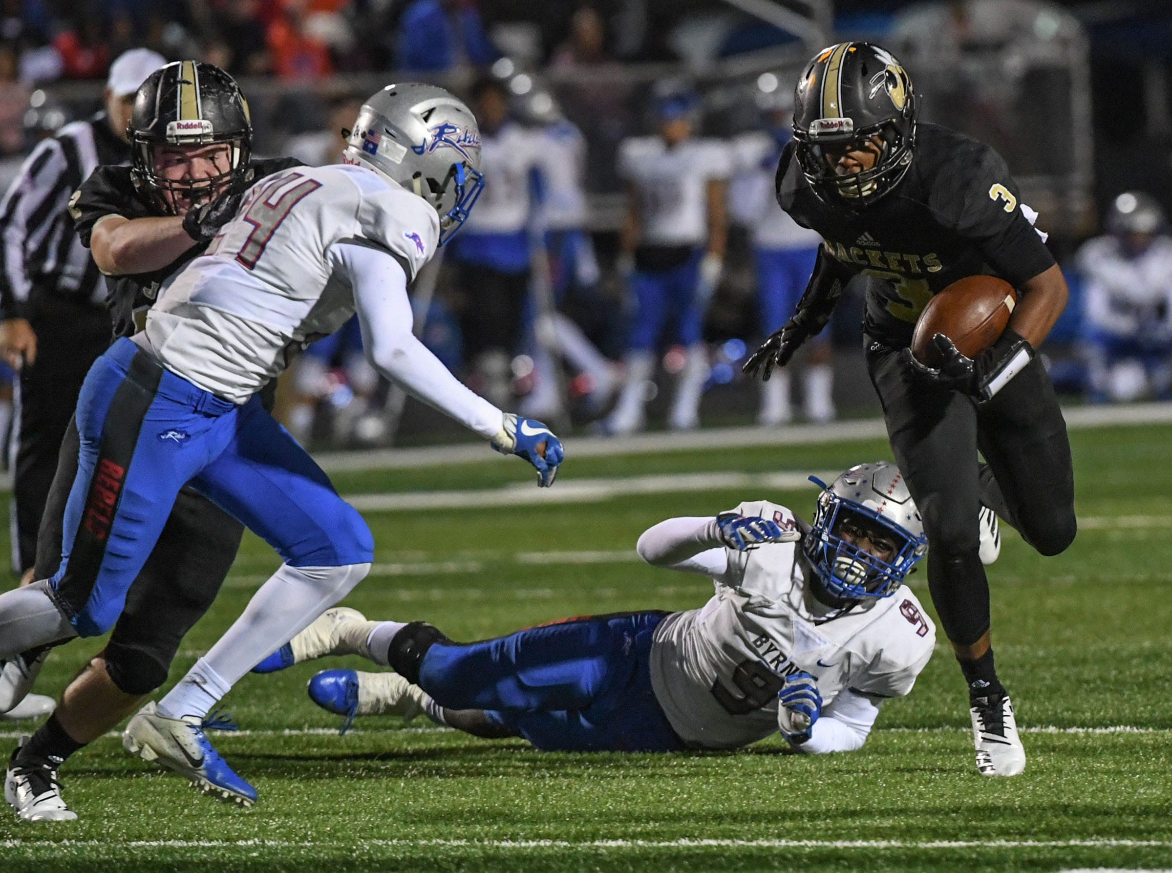 TL Hanna sophomore Jeremiah Hudson (3) runs near Byrnes senior Jojo Irby (9) during the second quarter of the Class AAAAA state playoffs at TL Hanna High School in Anderson on Friday, November 30, 2018.