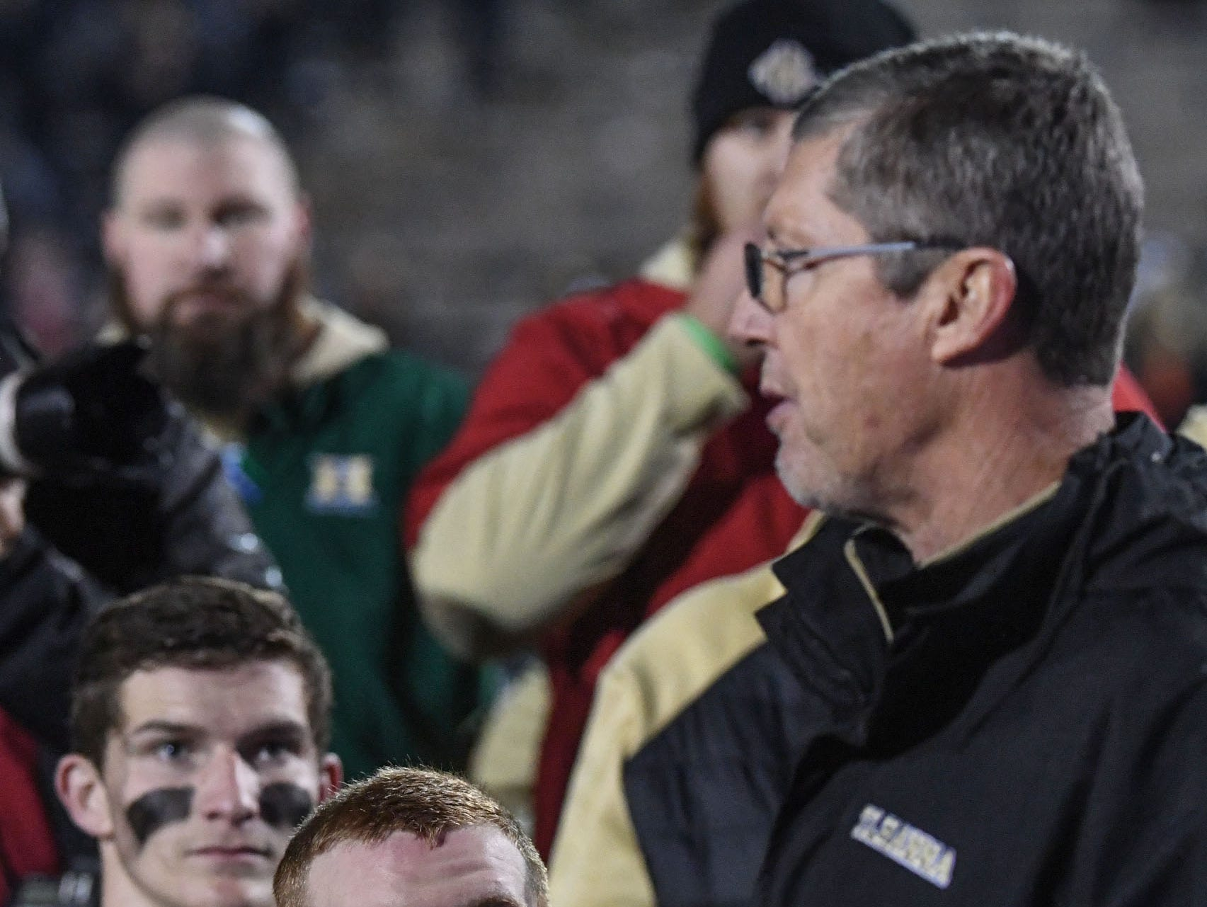 TL Hanna senior Alex Meredith (1) looks up listening to head coach Jeff Herron after a 57-28 TL Hanna High School win over Byrnes High School after the game of the Class AAAAA state playoffs at TL Hanna High School in Anderson on Friday, November 30, 2018.