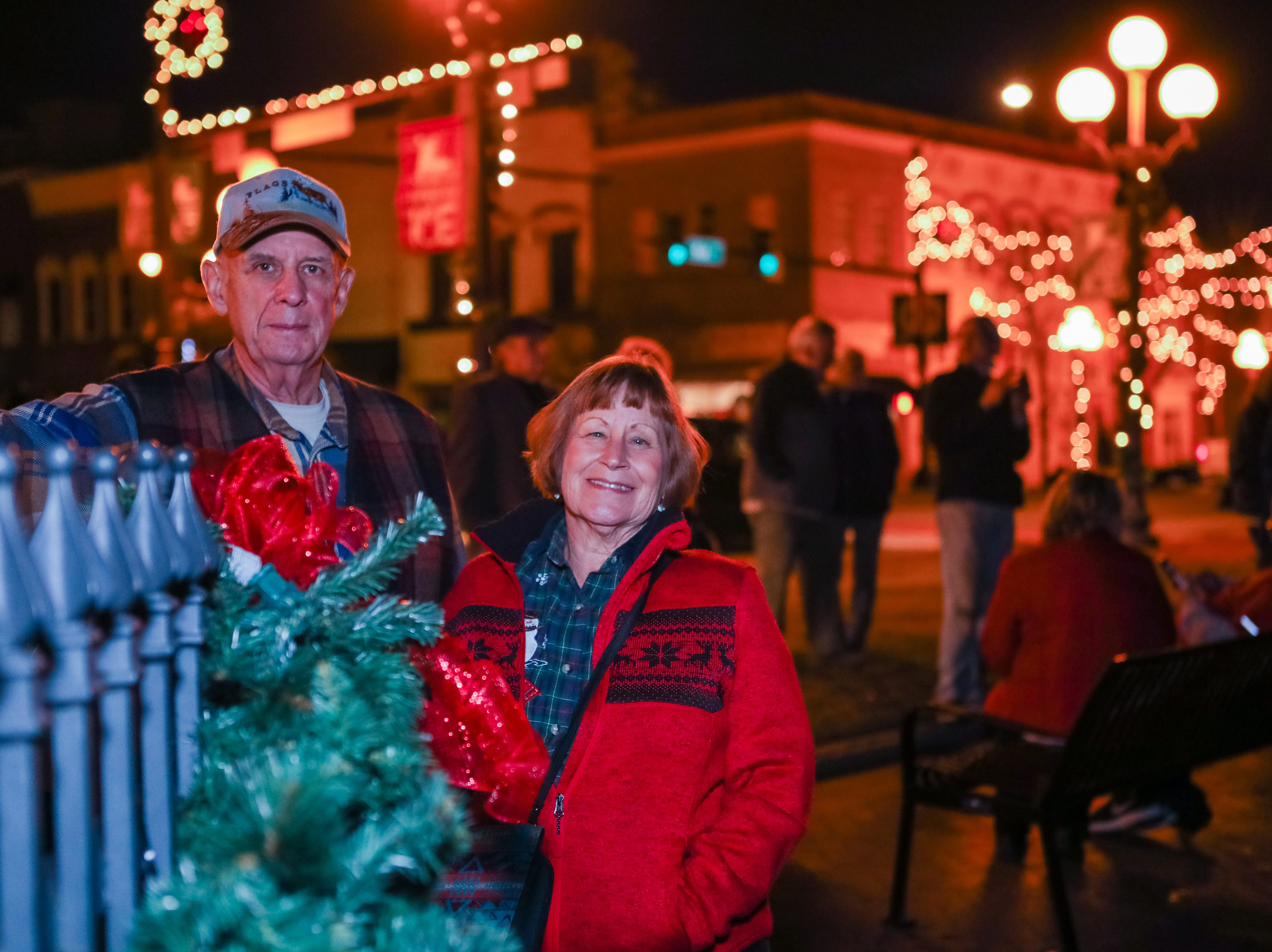 Ed and Elizabeth Young watch the tree lighting at the Piedmont Natural Gas Holiday Walk and Christmas Tree Lighting in downtown Anderson