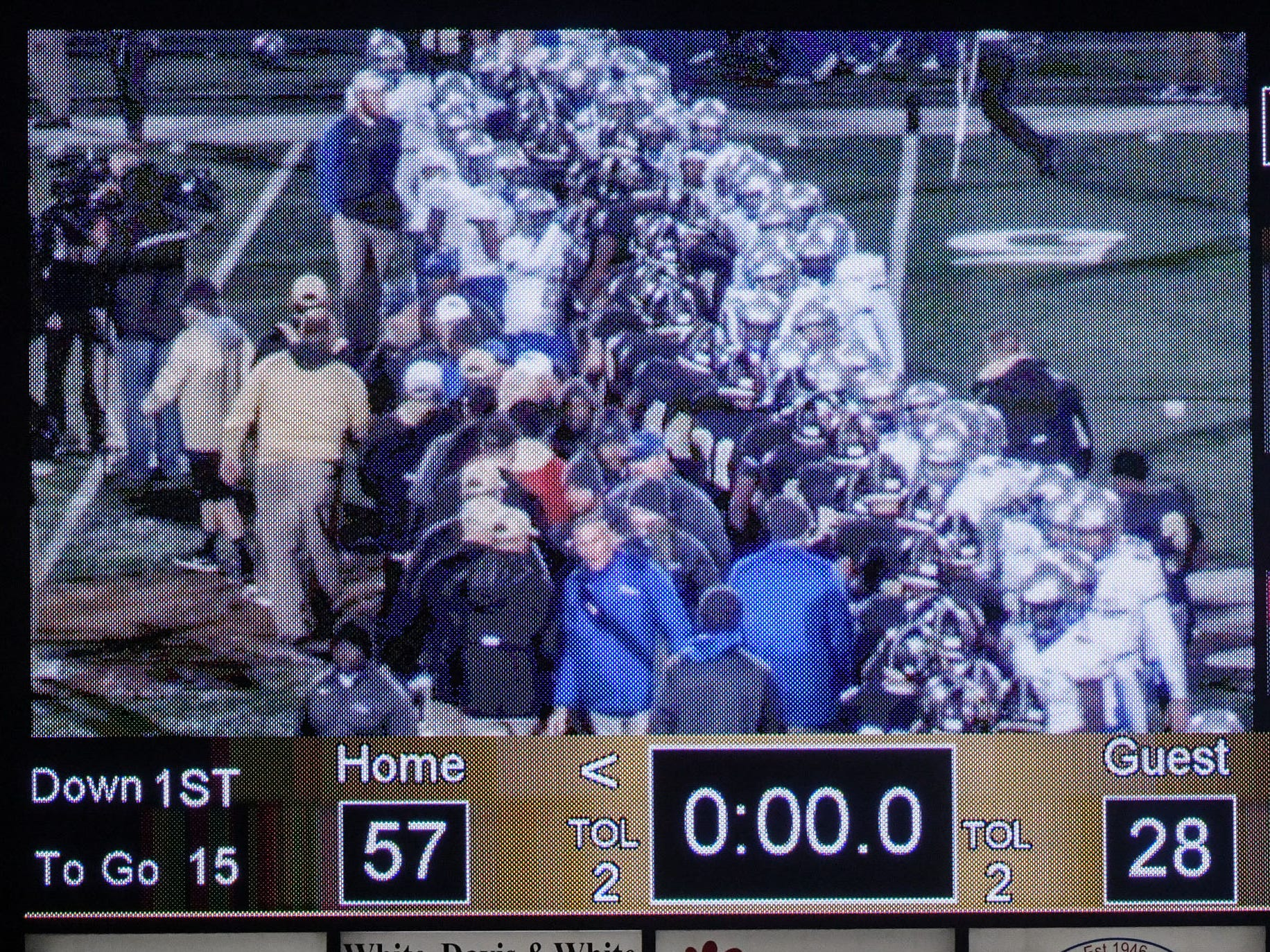 The scoreboard video shows players shaking hands after a 57-28 TL Hanna High School win over Byrnes High School after the game of the Class AAAAA state playoffs at TL Hanna High School in Anderson on Friday, November 30, 2018.