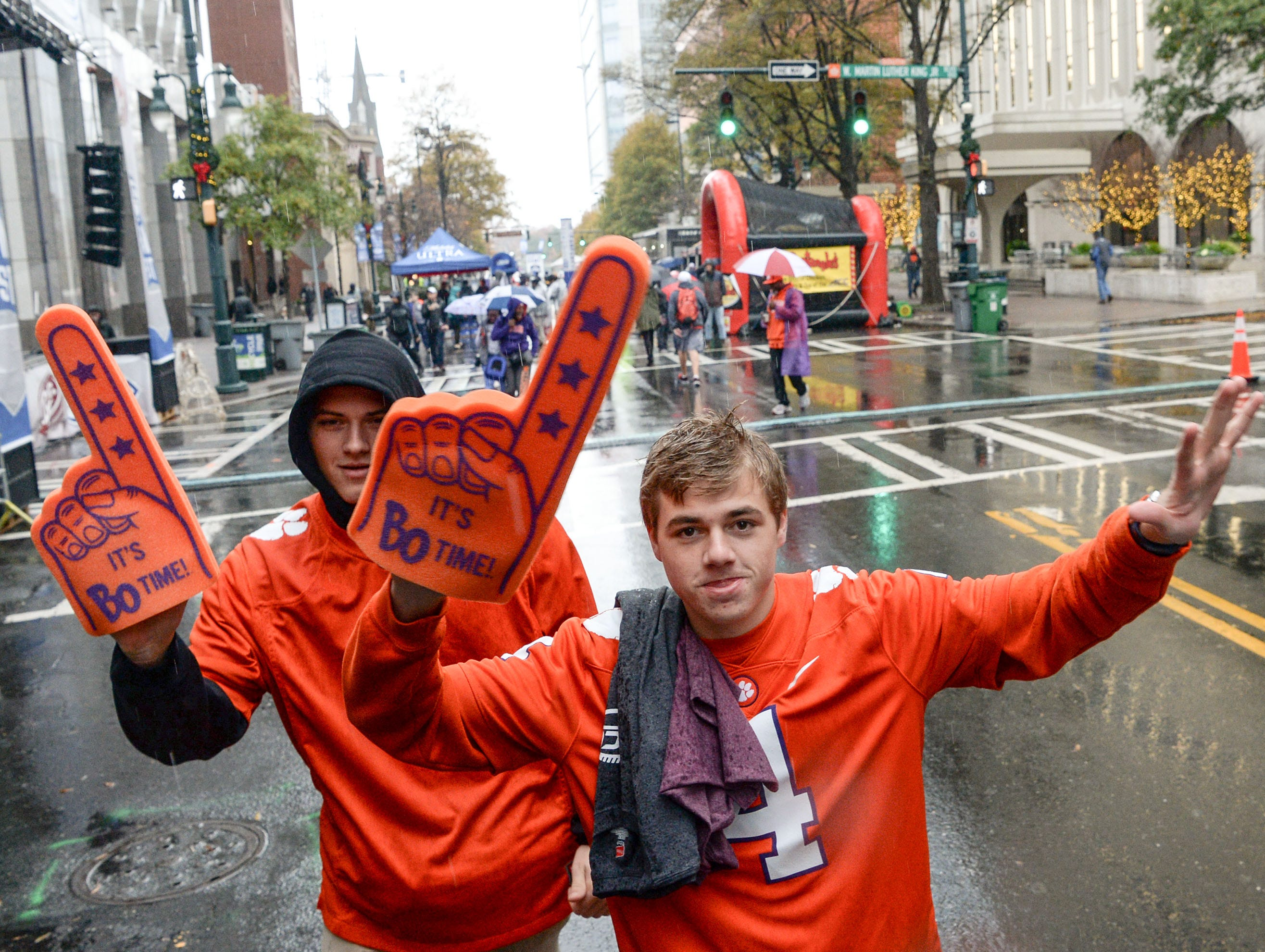 Clemson fans Carter Whaley, left, and Jake Pesickal, right, at the ACC Fan Fest in downtown Charlotte on Saturday, December 1, 2018.