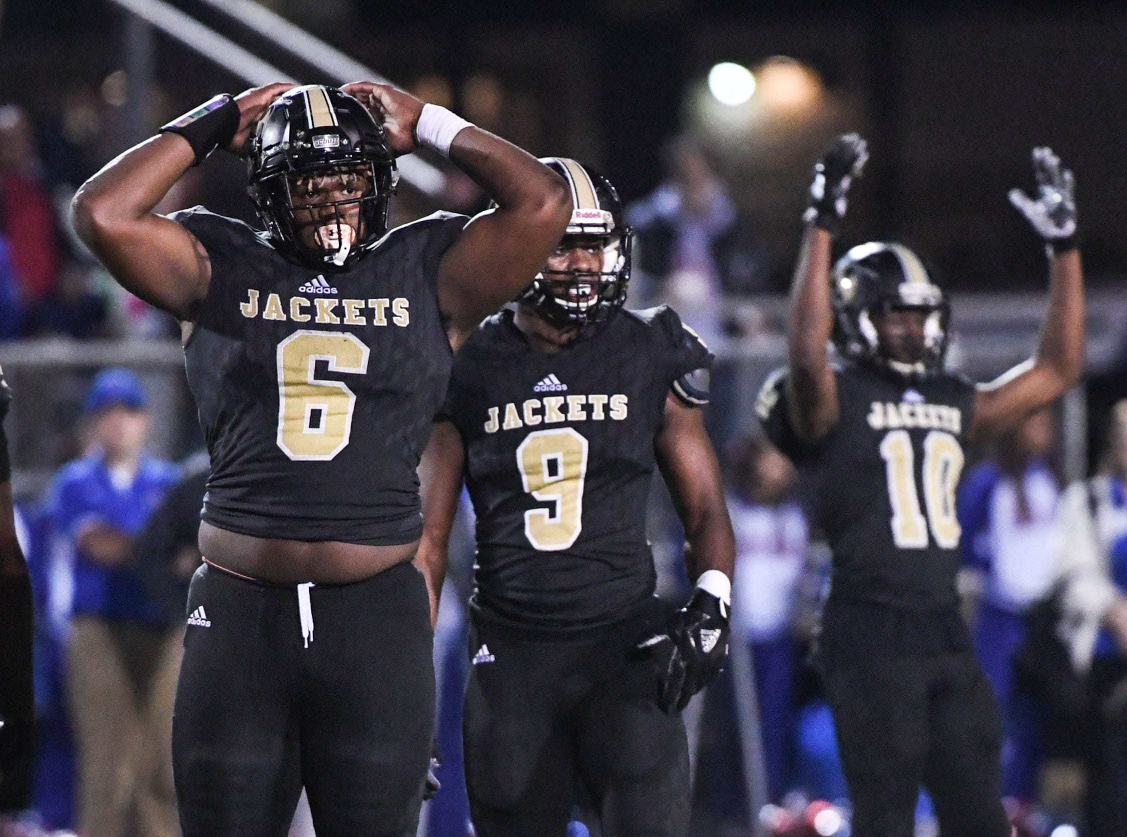 TL Hanna senior Zacch Pickens (6), left, Jay Lagroon (9) and Preston Pettway (10) wave to the crowd to get noisy against Byrnes during the first quarter of the Class AAAAA state playoffs at TL Hanna High School in Anderson on Friday, November 30, 2018.