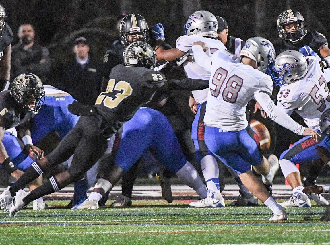TL Hanna senior Isaiah Norris (23) blocks an extra point attempt by Byrnes Clayton Crile (98) during the first quarter of the Class AAAAA state playoffs at TL Hanna High School in Anderson on Friday, November 30, 2018.