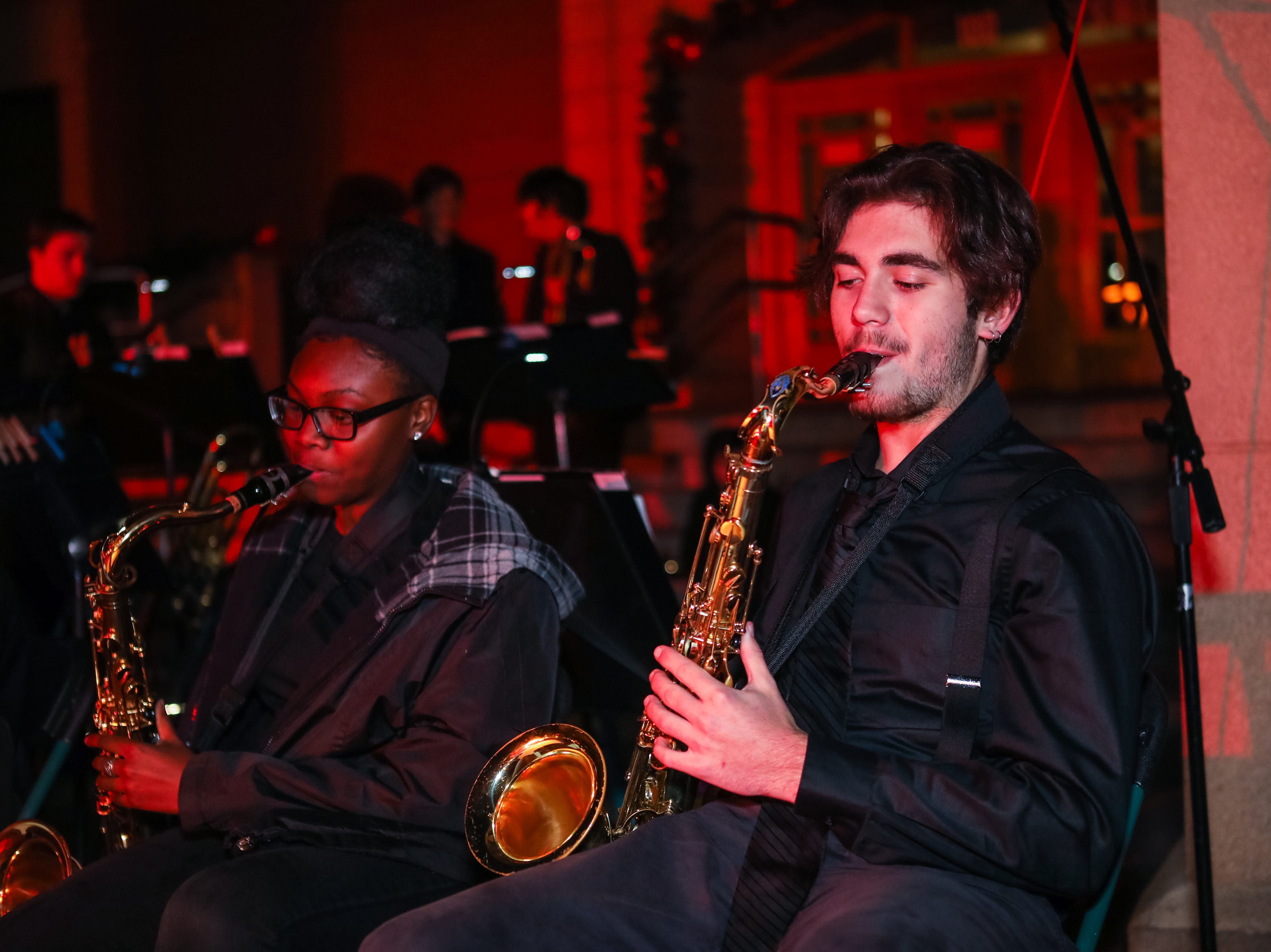 Zyeah Sullivan and Gavin Worley play the sax during the Piedmont Natural Gas Holiday Walk and Christmas Tree Lighting in downtown Anderson
