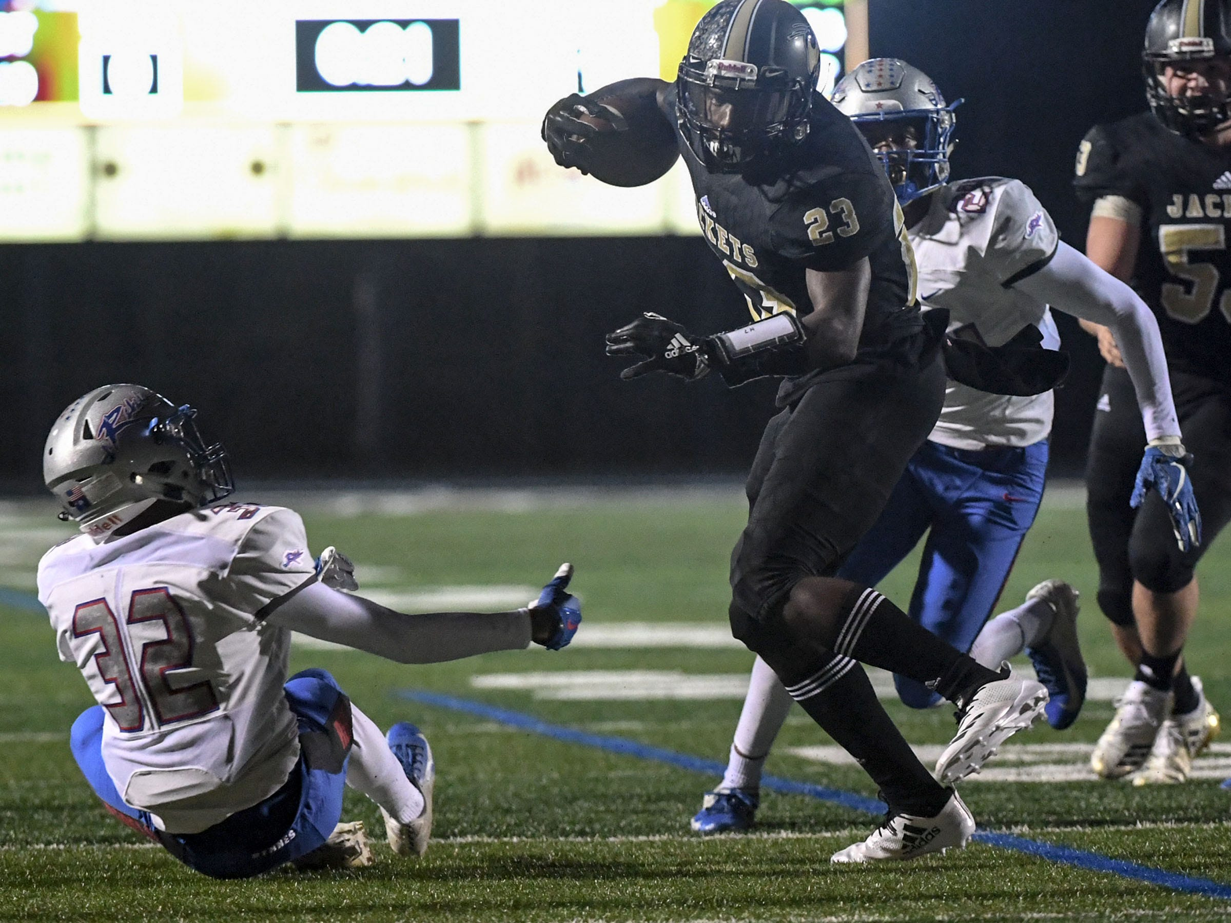 TL Hanna senior Isaiah Norris (23) runs near Byrnes junior Nijae Crouch (32) during the first quarter of the Class AAAAA state playoffs at TL Hanna High School in Anderson on Friday, November 30, 2018.