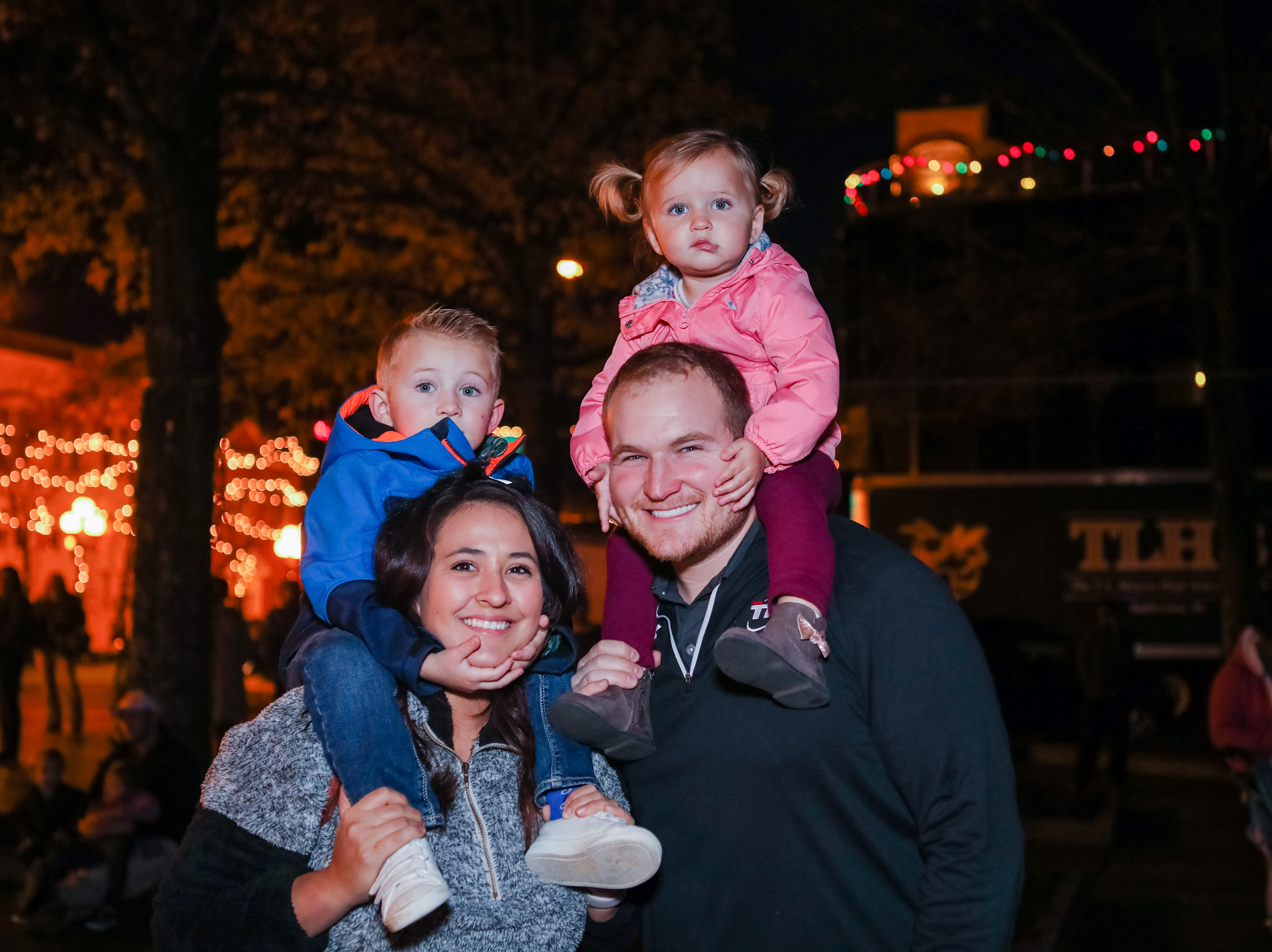 Miranda ,Tyler ,Trajan (3) and Mara (1) Murphey  wait to see the tree light up a the Piedmont Natural Gas Holiday Walk and Christmas Tree Lighting in downtown Anderson