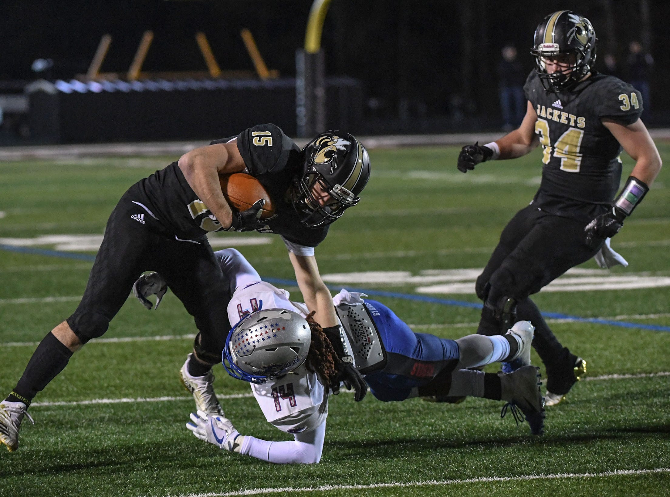 TL Hanna junior Jackson Pusey (15) is tackled by Byrnes junior Buddy Mack (14)  during the first quarter of the Class AAAAA state playoffs at TL Hanna High School in Anderson on Friday, November 30, 2018.