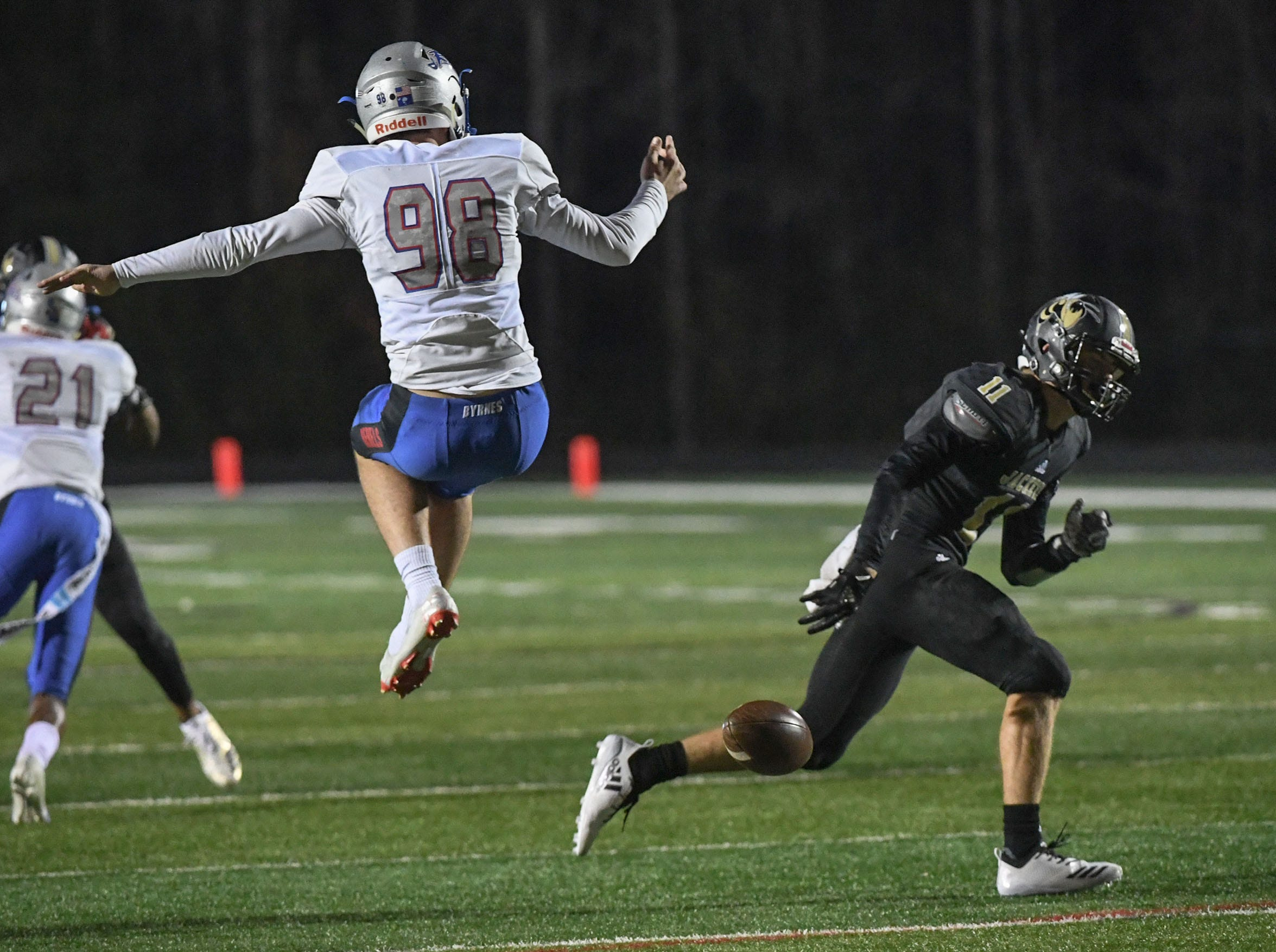 TL Hanna senior Trey Palmer (11) blocks a punt attempt by Byrnes Clayton Crile (98) during the first quarter of the Class AAAAA state playoffs at TL Hanna High School in Anderson on Friday, November 30, 2018.
