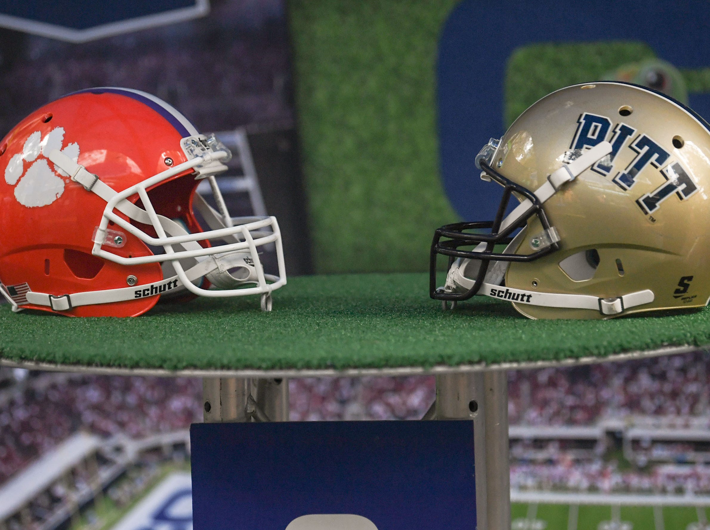 A Clemson and Pitt helmet on display at the ACC Fan Fest in downtown Charlotte on Saturday, December 1, 2018.