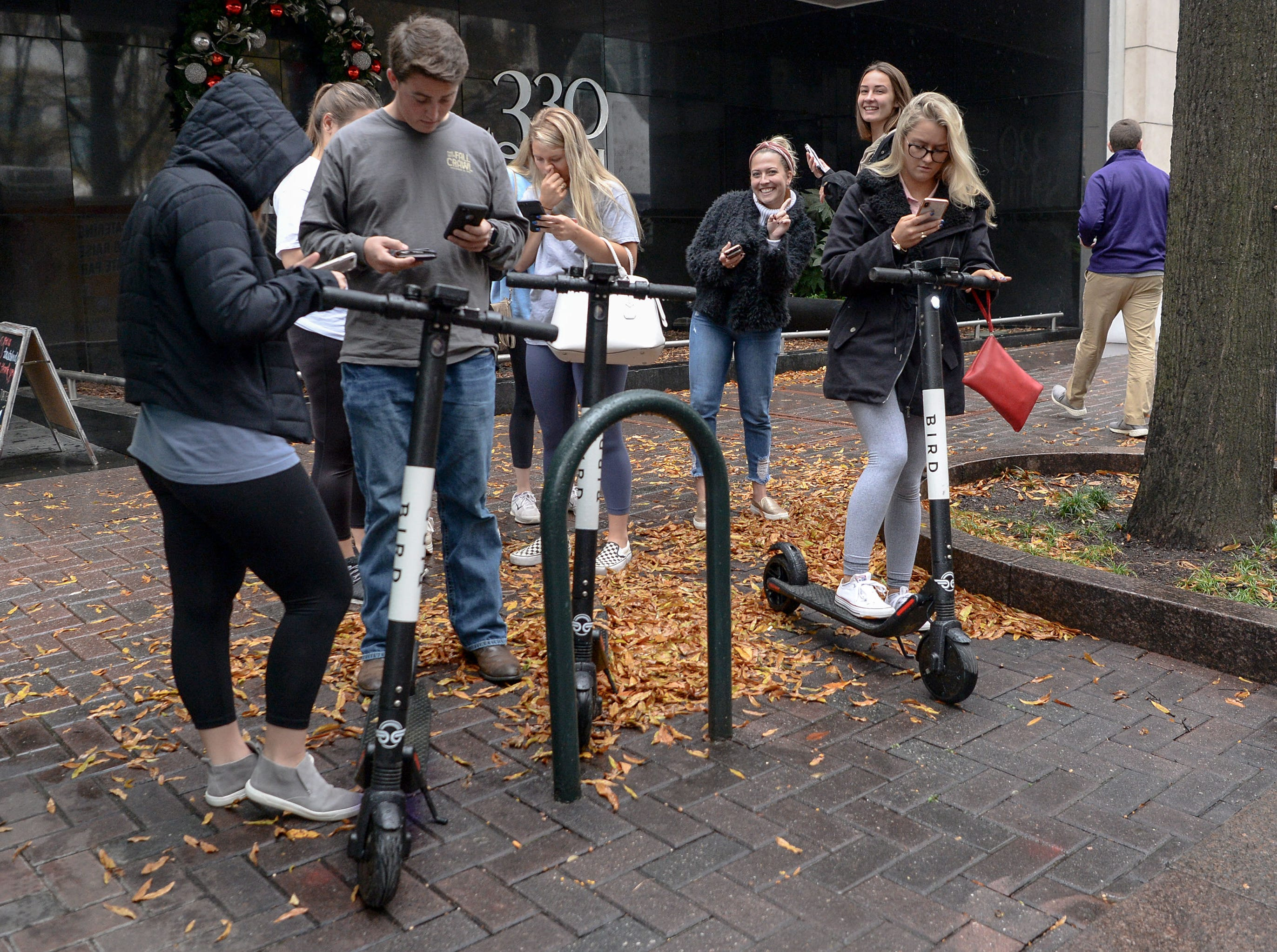 Fans rent scooters at the ACC Fan Fest in downtown Charlotte on Saturday, December 1, 2018.