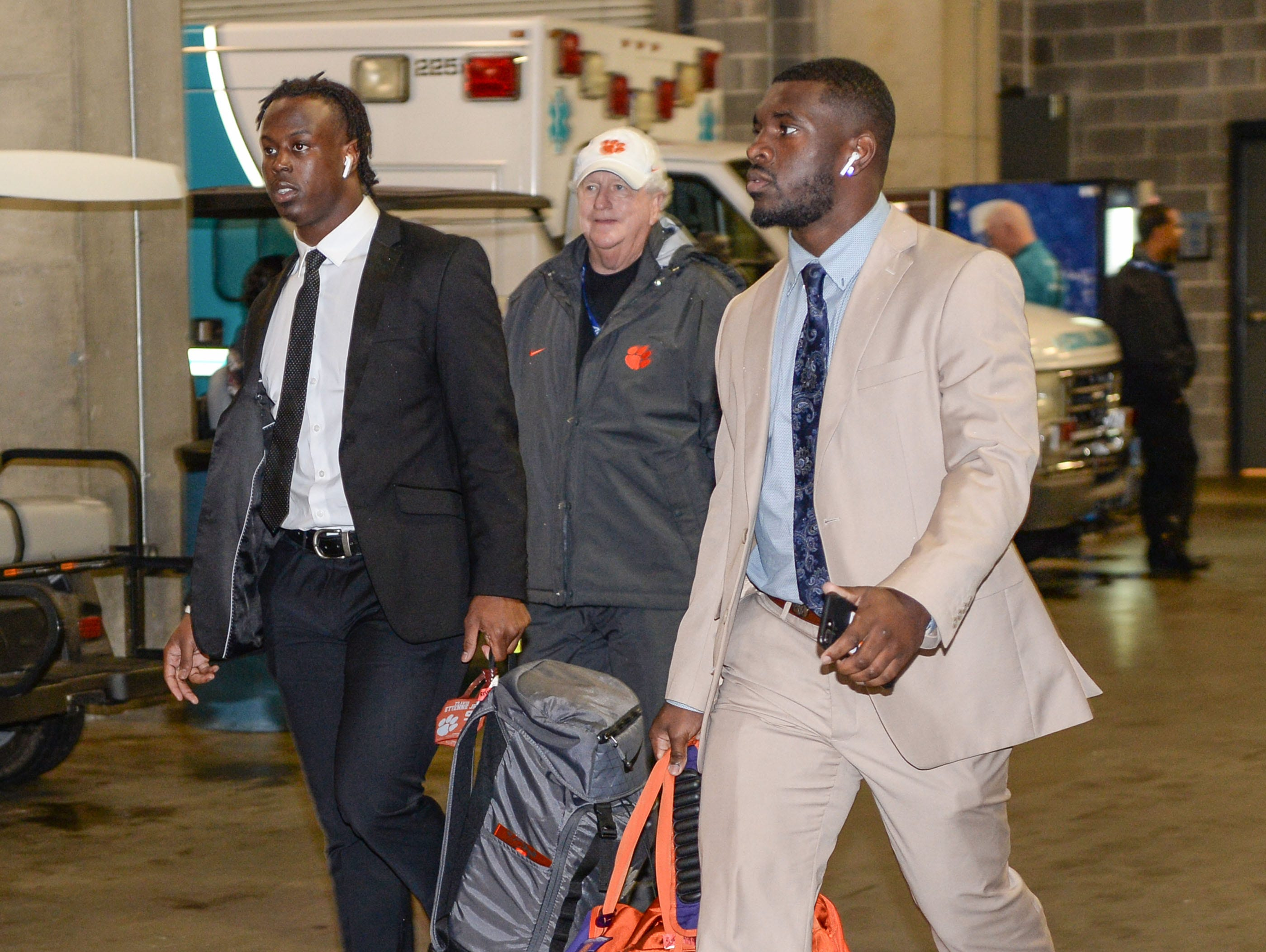 Clemson running back Travis Etienne (9) and running back Tavien Feaster (28) arrive before the game with Pittsburgh at the Dr. Pepper ACC football championship at Bank of America Stadium in Charlotte, N.C. on Saturday, December 1, 2018.
