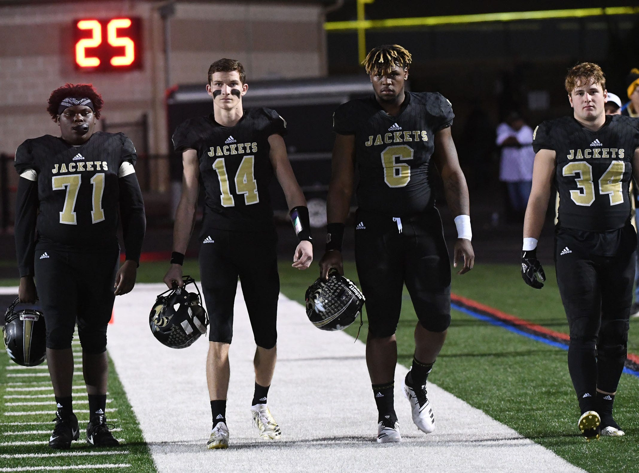 TL Hanna High School captains arrive before the kickoff of the Class AAAAA state playoffs at TL Hanna High School in Anderson on Friday, November 30, 2018.