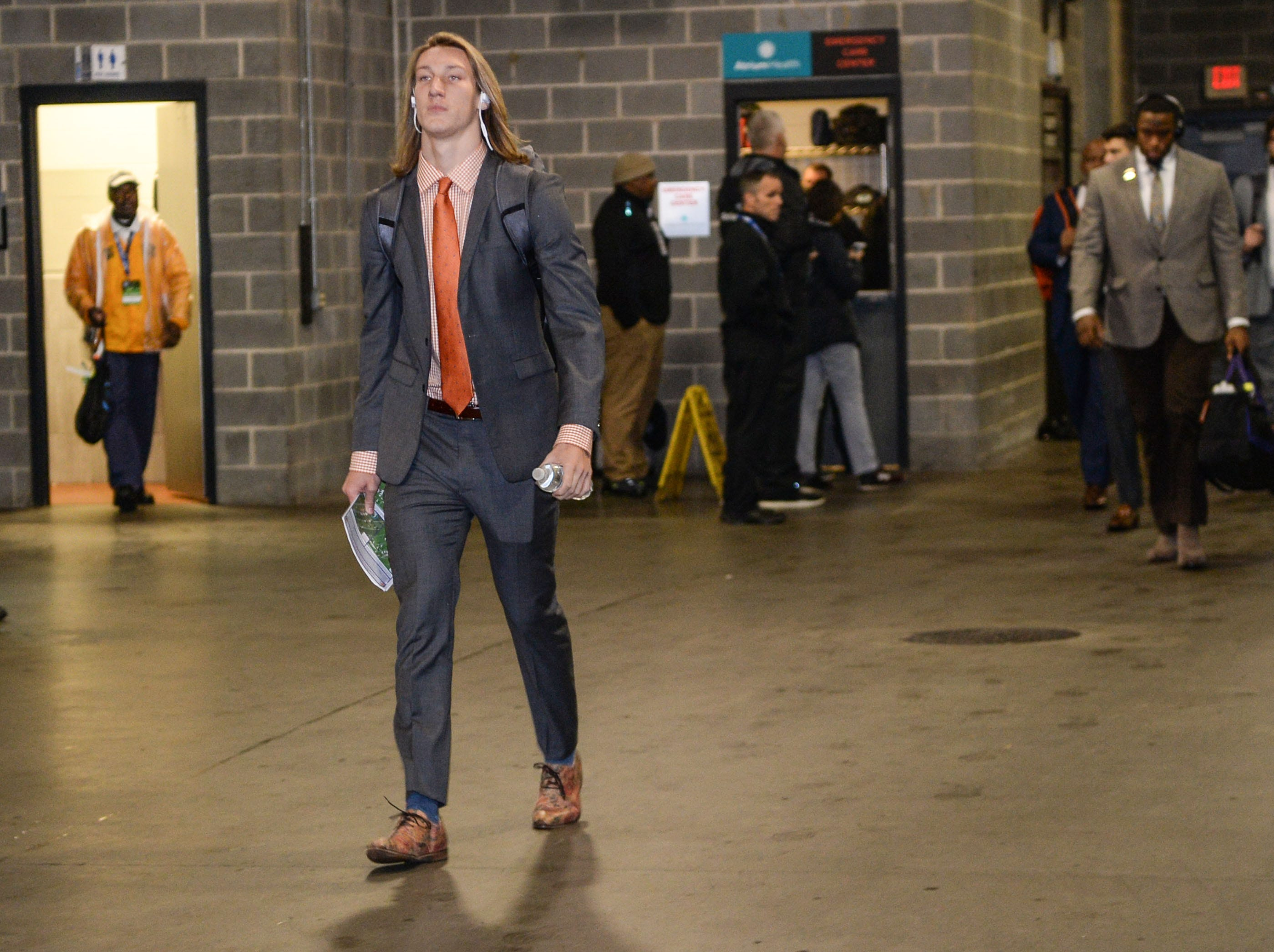 Clemson quarterback Trevor Lawrence (16) arrives before the game with Pittsburgh at the Dr. Pepper ACC football championship at Bank of America Stadium in Charlotte, N.C. on Saturday, December 1, 2018.