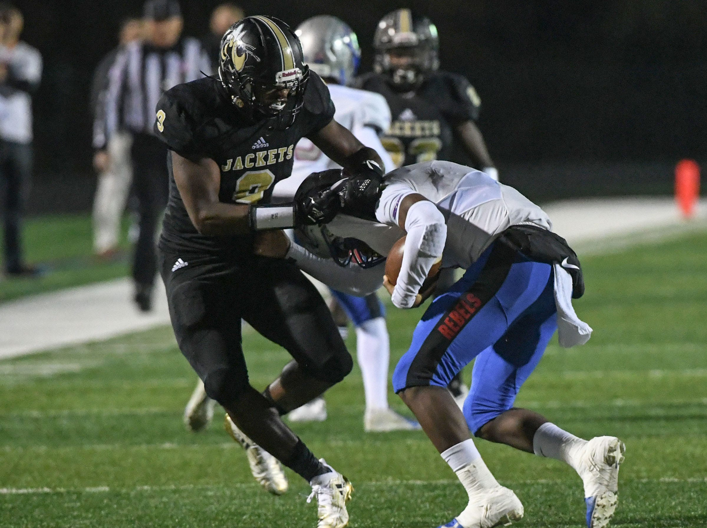 TL Hanna senior Jay Lagroon (9) tackle Byrnes senior BJ Peake (1) during the first quarter of the Class AAAAA state playoffs at TL Hanna High School in Anderson on Friday, November 30, 2018.