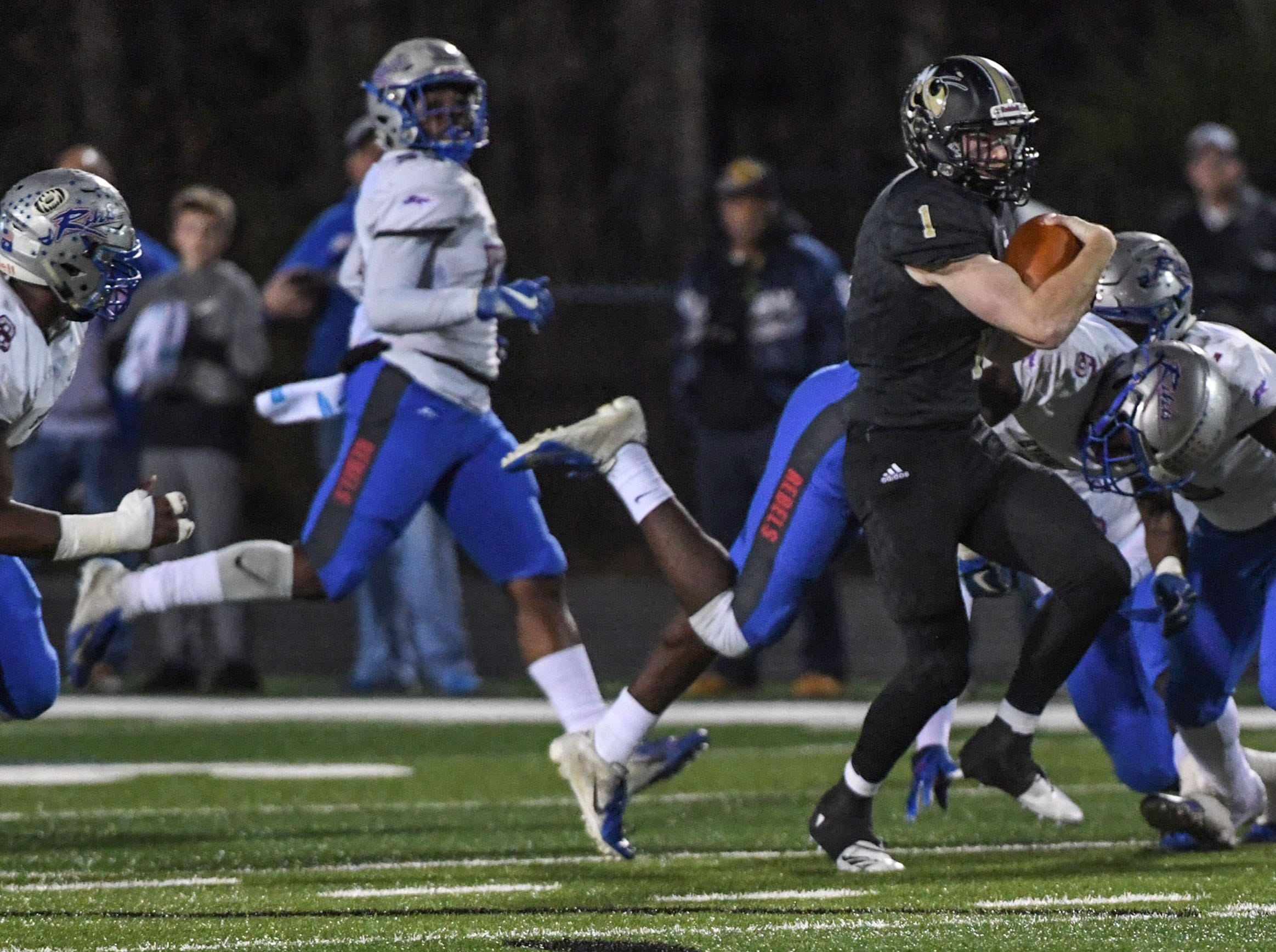 TL Hanna senior Alex Meredith (1) runs against Byrnes High School during the first quarter of the Class AAAAA state playoffs at TL Hanna High School in Anderson on Friday, November 30, 2018.