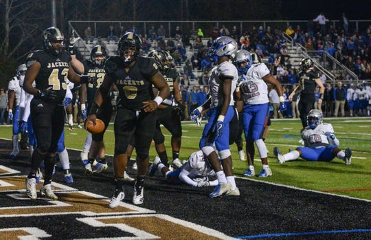 TL Hanna senior Zacch Pickens (6) scores a two-point conversion against Byrnes High School during the second quarter of the Class AAAAA state playoffs at TL Hanna High School in Anderson on Friday, November 30, 2018.