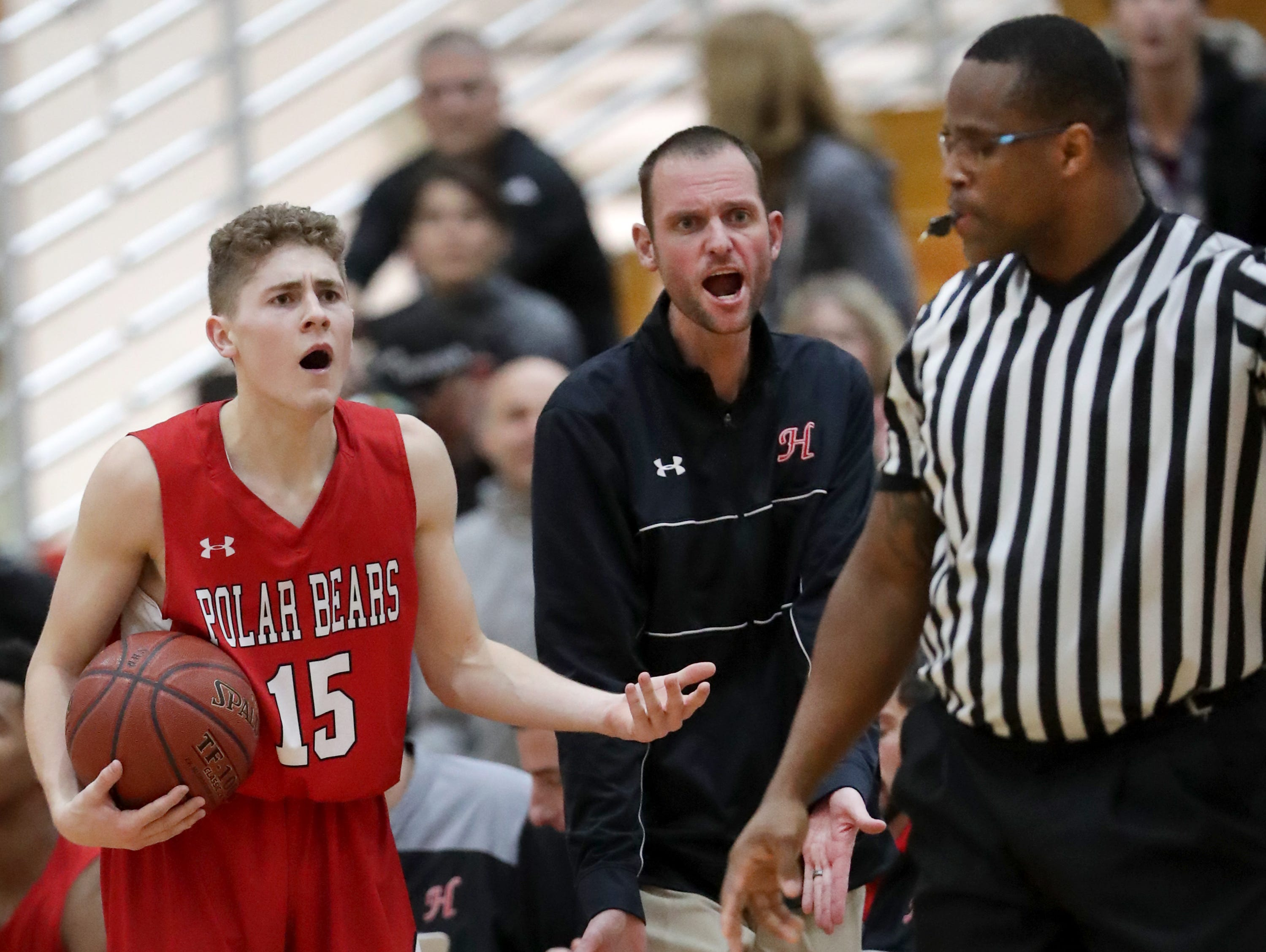 Hortonville High School's #15 Cole Warning argues an out of bounds call in the final seconds of overtime against Neenah High School during their Fox Valley Association boys basketball game on Friday, November 30, 2018, in Neenah, Wis. Neenah defeated Hortonville 71 to 67 in overtime.Wm. Glasheen/USA TODAY NETWORK-Wisconsin.