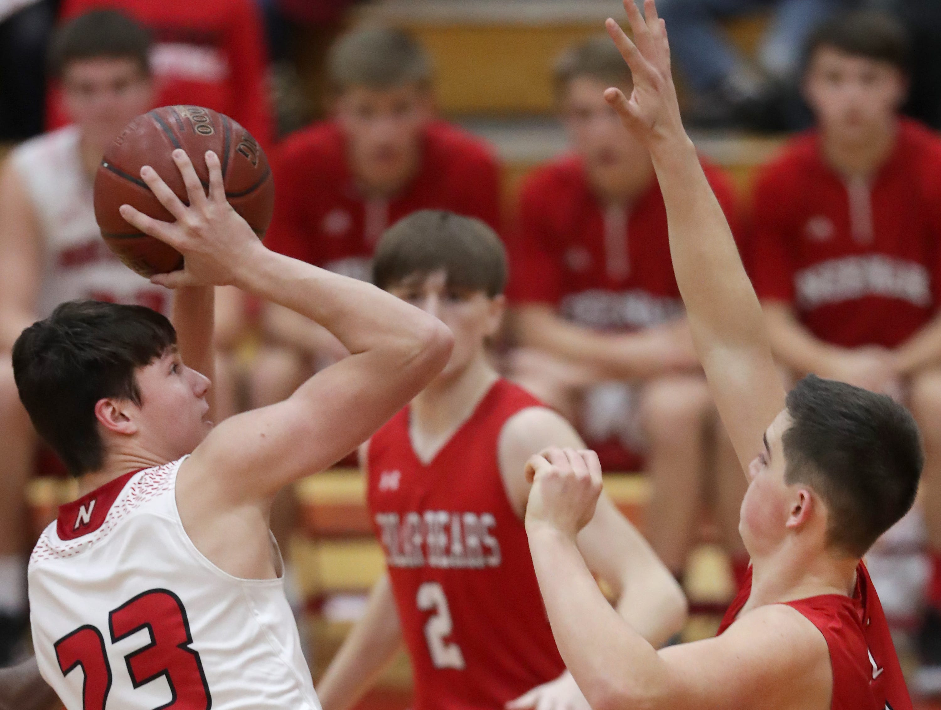 Neenah High School's #23 Ethan Parker against Hortonville High School's #5 Noah Meyer during their Fox Valley Association boys basketball game on Friday, November 30, 2018, in Neenah, Wis. Neenah defeated Hortonville 71 to 67 in overtime.Wm. Glasheen/USA TODAY NETWORK-Wisconsin.