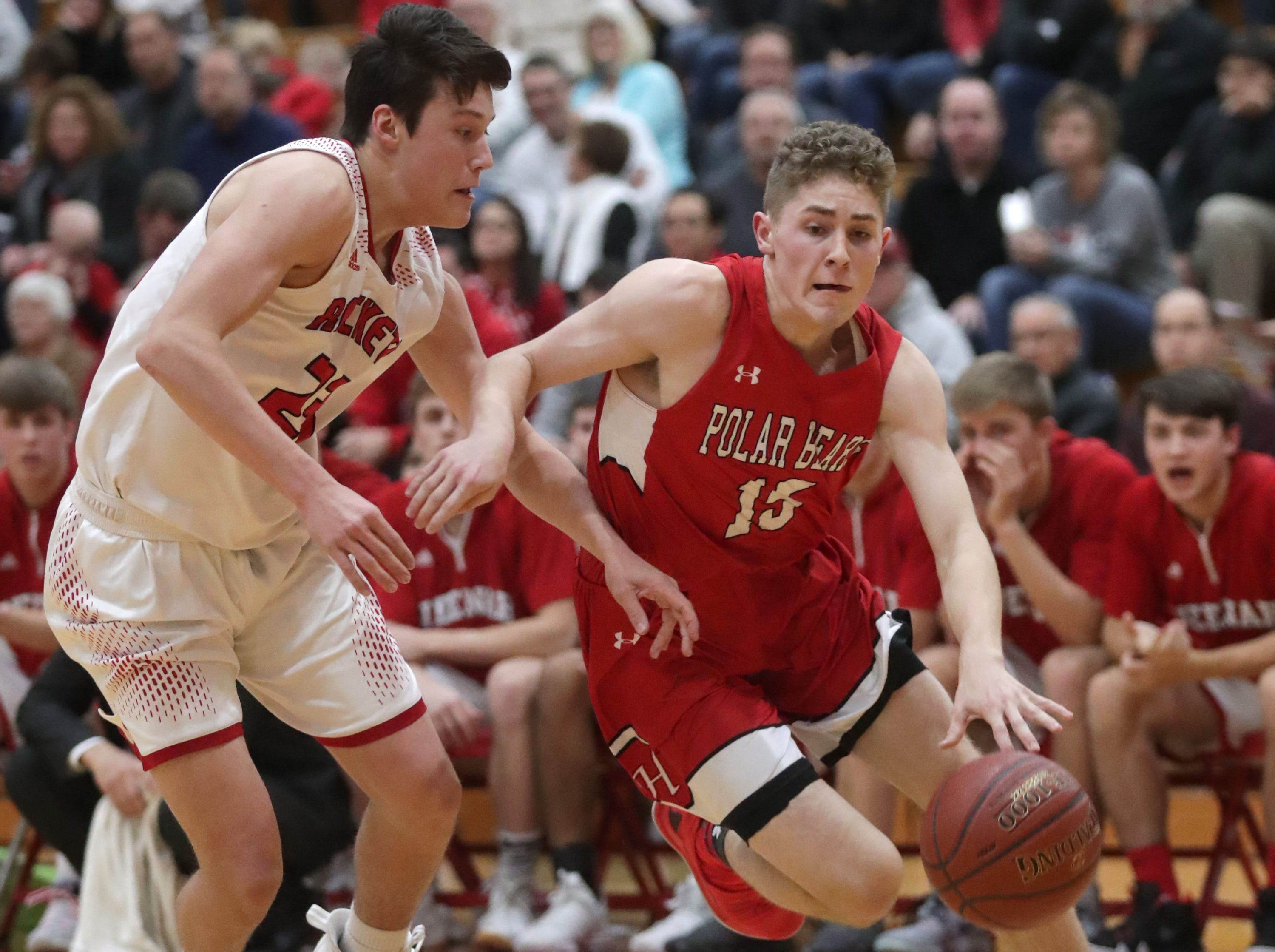 Neenah High School's #23 Ethan Parker against Hortonville High School's #15 Cole Warning during their Fox Valley Association boys basketball game on Friday, November 30, 2018, in Neenah, Wis. Neenah defeated Hortonville 71 to 67 in overtime.Wm. Glasheen/USA TODAY NETWORK-Wisconsin.