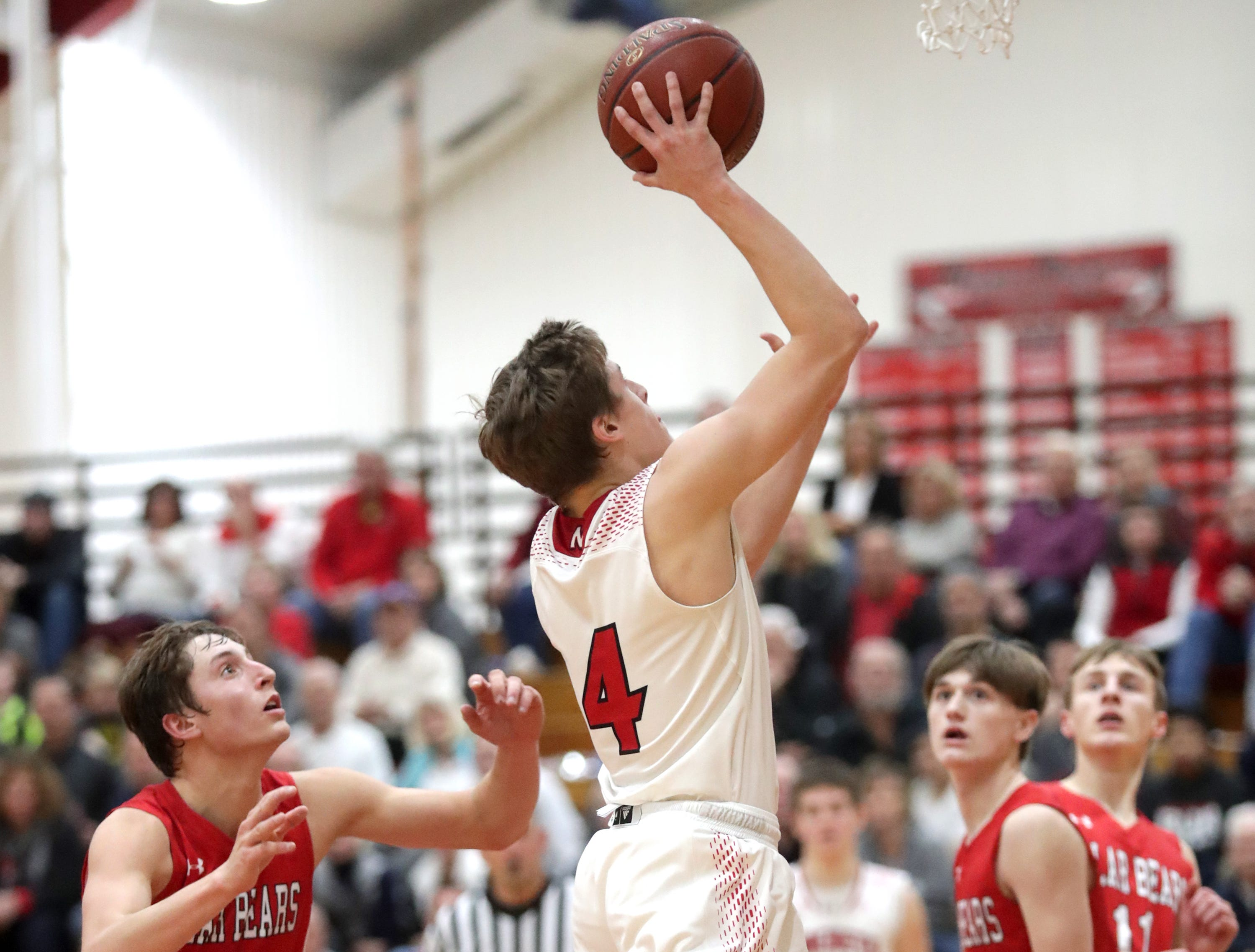 Neenah High School's #4 Peyton Mellenthin shoots the go ahead basket in overtime against Hortonville High School during their Fox Valley Association boys basketball game on Friday, November 30, 2018, in Neenah, Wis. Neenah defeated Hortonville 71 to 67 in overtime.Wm. Glasheen/USA TODAY NETWORK-Wisconsin.