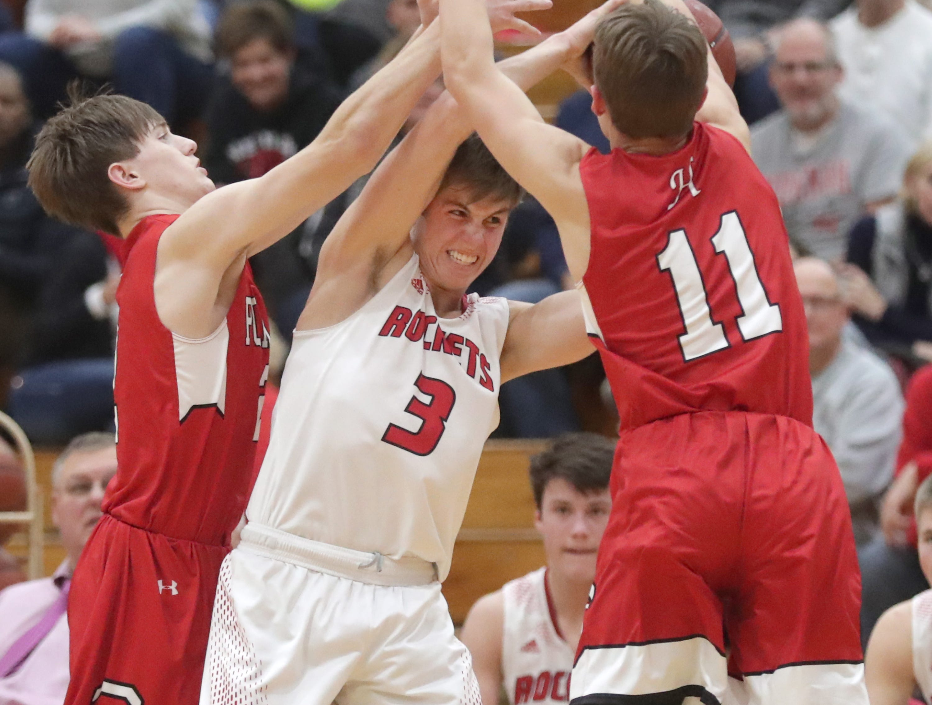 Neenah High School's #3 Sam Dietrich against Hortonville High School's #2 Parker Lawrence, left, and #11 Mitch Tandeski during their Fox Valley Association boys basketball game on Friday, November 30, 2018, in Neenah, Wis. Neenah defeated Hortonville 71 to 67 in overtime.Wm. Glasheen/USA TODAY NETWORK-Wisconsin.