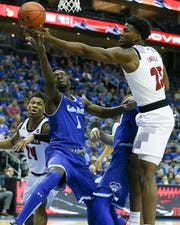 Seton Hall Pirates forward Michael Nzei (1) rebounds against Louisville Cardinals center Steven Enoch (23)
