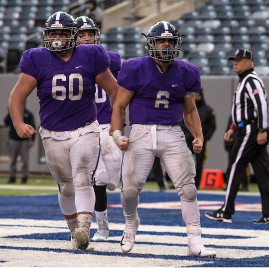 Rumson-Fair Haven's Alex Maldjian celebrates after scoring late in the game. Rumson-Fair Haven defeats Woodrow Wilson in the NJSIAA South Group III Bowl Game at MetLife Stadium. 