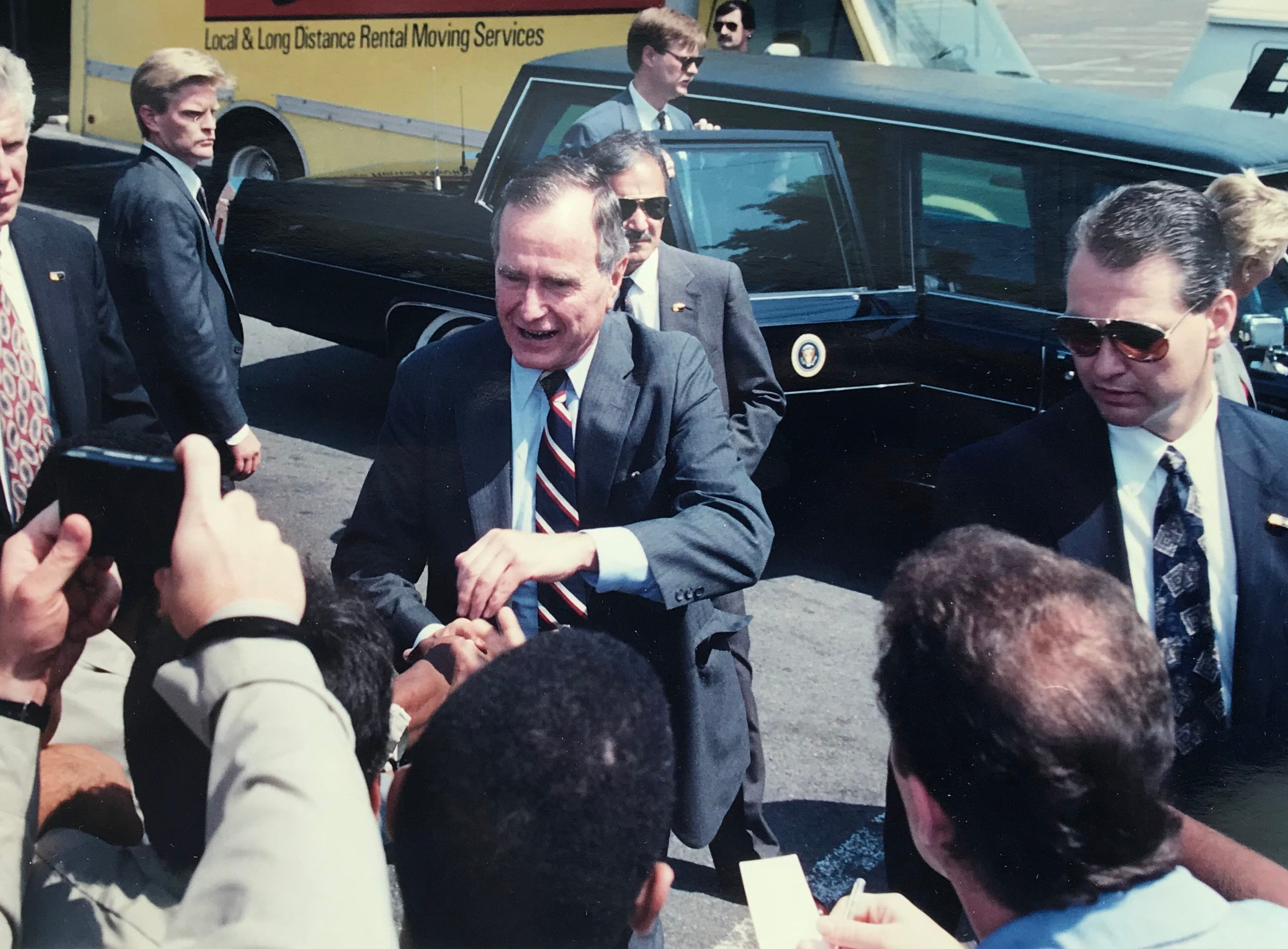 President George Bush shakes hands as he heads back to his helicopter after a stop at Lincoln Technical Institute in Union on Aug. 24, 1992.
