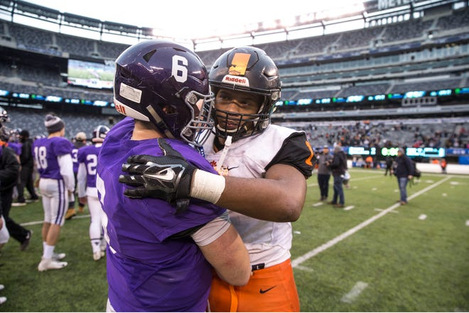 Rumson-Fair Haven's Alex Maldjian shakes hands with Woodrow Wilson junior Muheem McCargo after Saturday's NJSIAA Central/South Group 3 Bowl Game at MetLife Stadium.