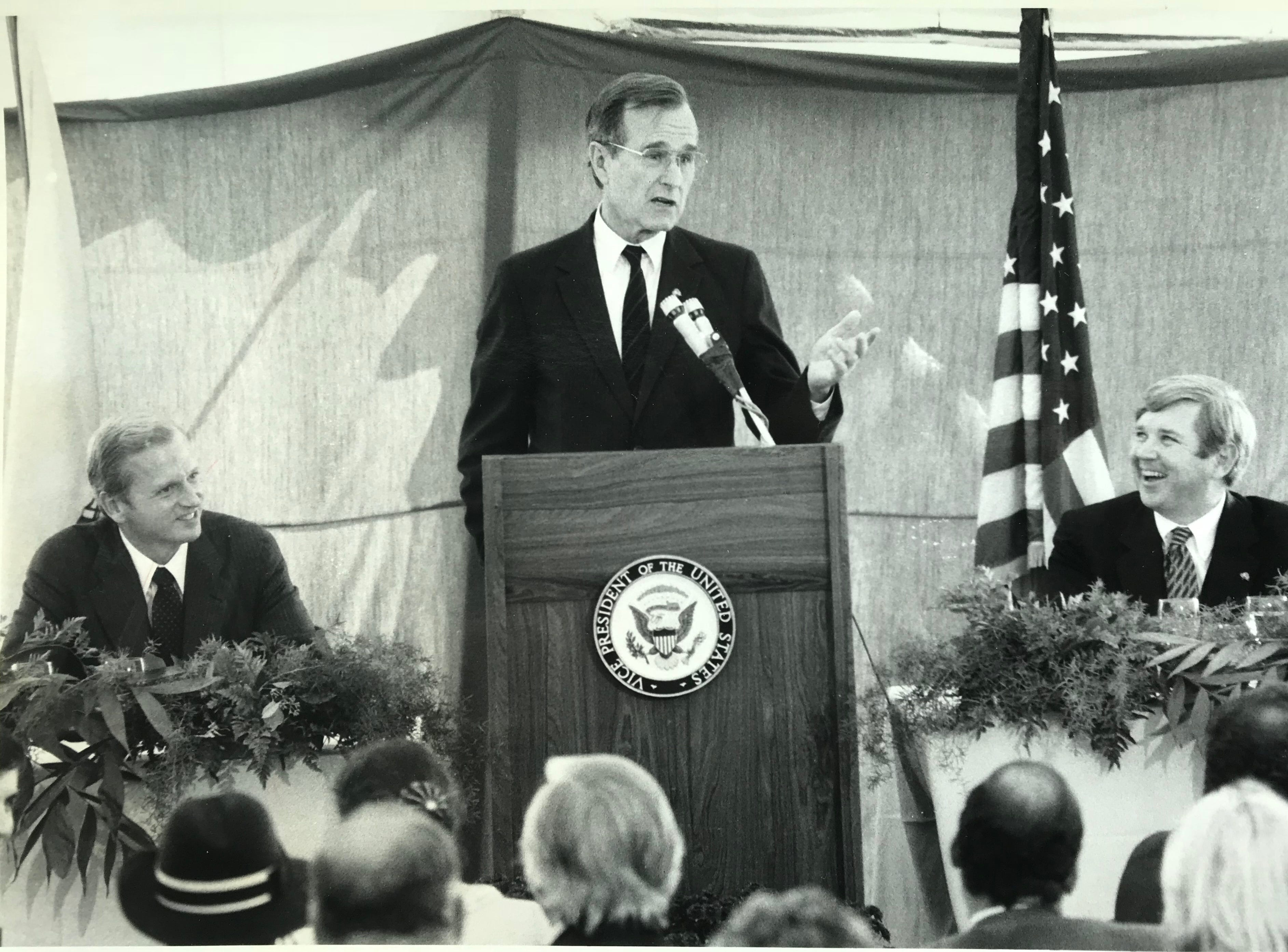 Vice President George H.W. Bush speaks at a Republican fundraiser in Lakewood, with supporter and fundraiser Larry Bathgate II (right), in October 1983.