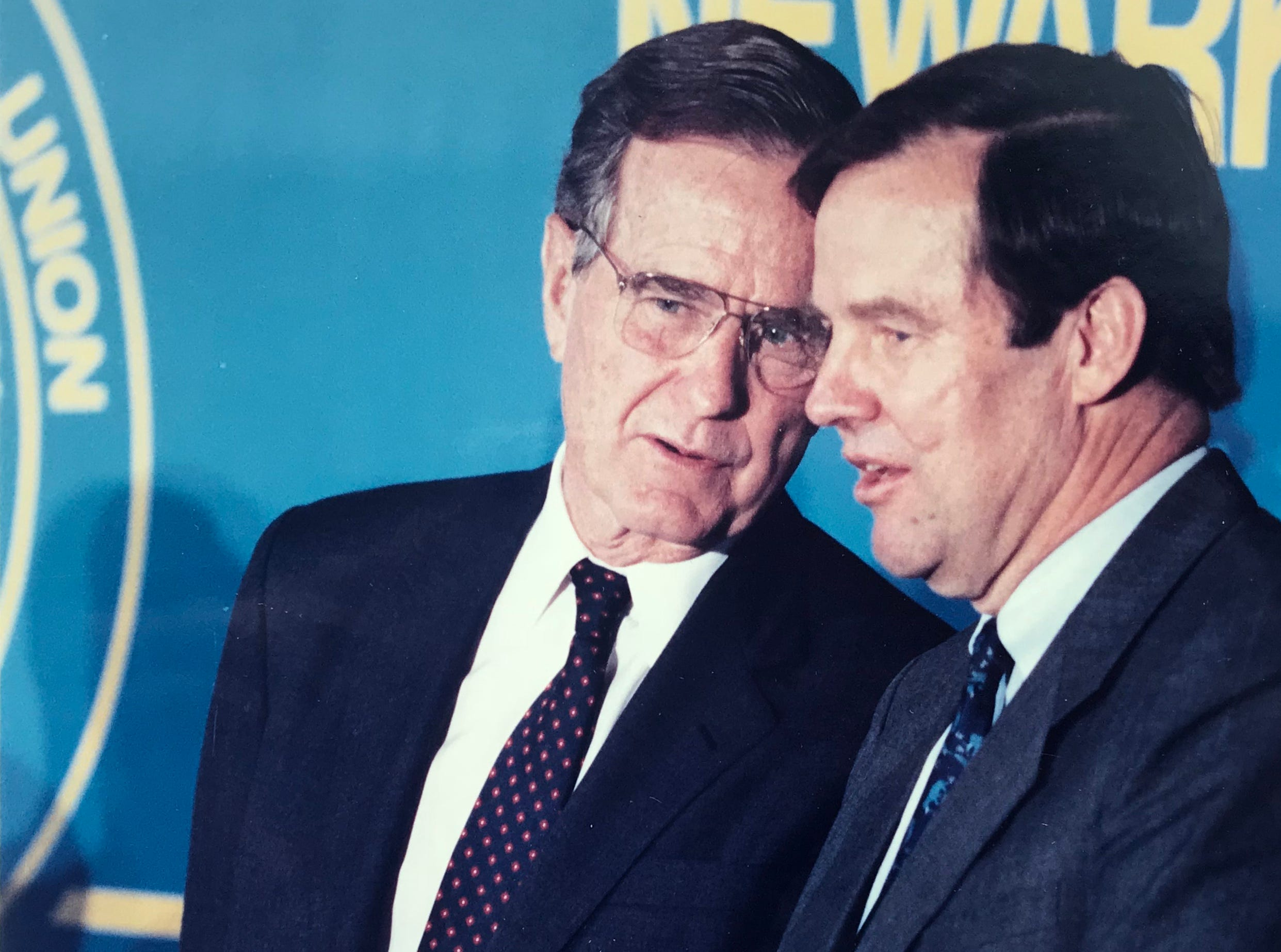 President George H.W. Bush talks with former New Jersey Gov. Tom Kean during a campaign stop in Newark in September 1992.