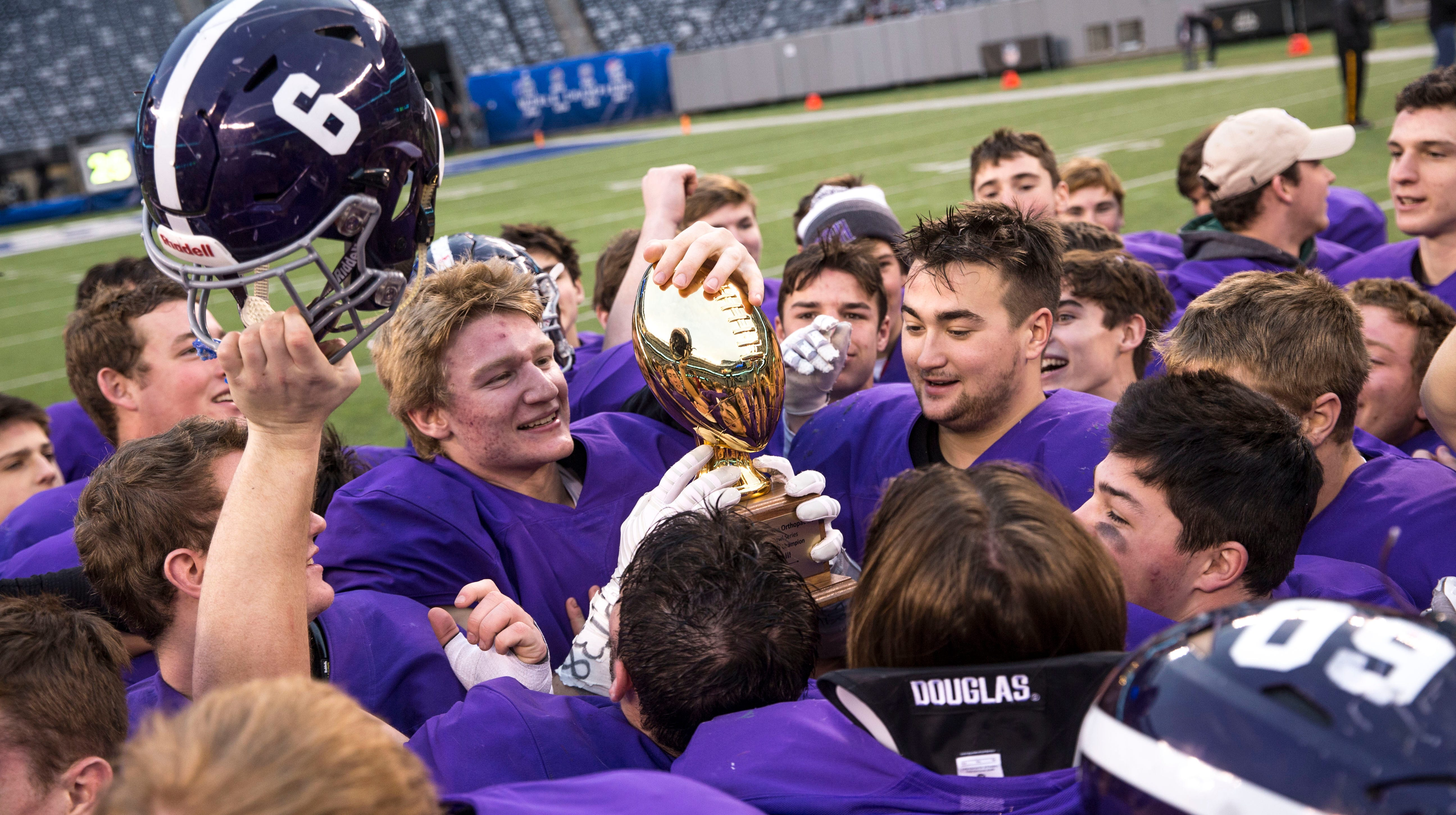 Rumson-Fair Haven's Ian O'Connor and Ethan Ardolino celebrate the win. Rumson-Fair Haven defeats Woodrow Wilson in the NJSIAA South Group III Bowl Game at MetLife Stadium.  East Rutherford, NJ Saturday, December 1, 2018