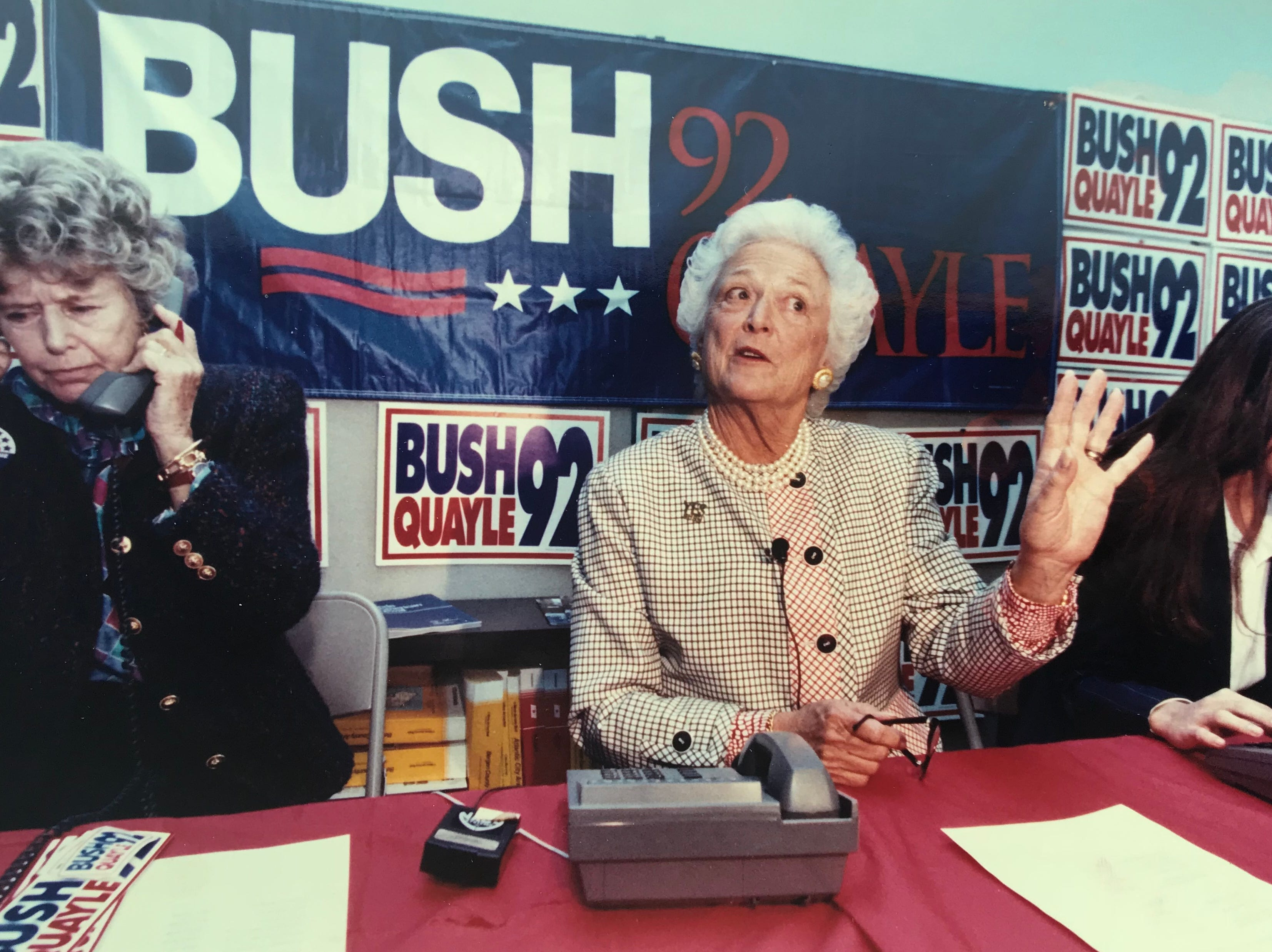 Barbara Bush talks with reporters while President Bush's sister, Nancy Ellis (left), and granddaughter Noelle Bush work the phone bank at Bergen County Republican Headquarters in Hackensack on Oct. 21, 1992.